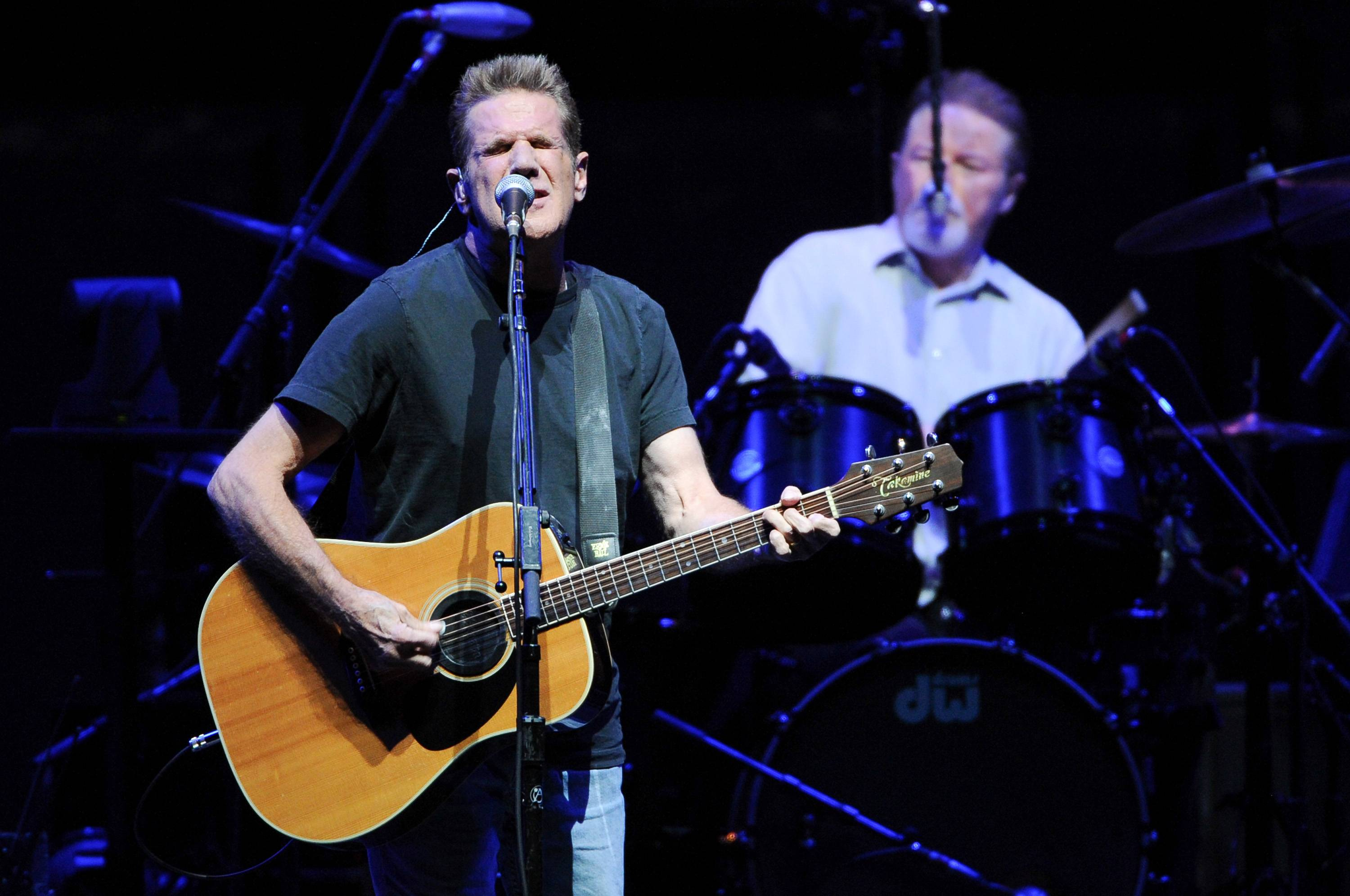Musicians Glenn Frey, left, and Don Henley, of the Eagles perform. Frey died Jan. 18 at age 67. He and Henley, like many artists of their generation, sang backup and collaborated with other famous musicians in their early years.