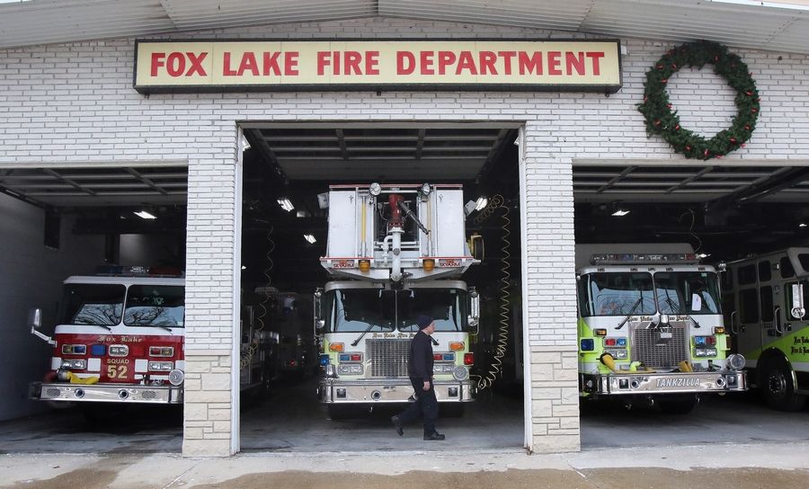 Fox Lake firefighter Josh Wigutow walks in front of station No. 2. Fox Lake voters in March will decide if the village should join the Fox Lake Fire Protection District or continue contracting with the agency for service.