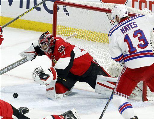 2d28b1a7a78 Ottawa Senators goaltender Craig Anderson (41) dives for the puck as New  York Rangers