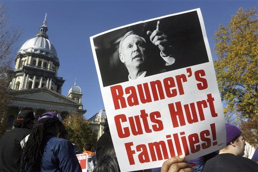 FILE - In this Nov. 10, 2015 file photo, protesters rally in support of lawmakers ending the state budget impasse at the Illinois state Capitol in Springfield. Gov. Bruce Rauner takes pride in not being like any of Illinois' previous governors. Unlike even his Republican predecessors, who often cut deals with Democrats and their labor union allies in the Legislature, Rauner brags about being the first to stand up to them, even as it's led to a record-breaking stalemate. Seven months after Illinois' last state budget expired, it still doesn't have a new one.