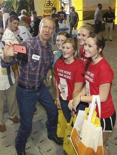 FILE - In this Sept. 2, 2015 file photo, Illinois Gov. Bruce Rauner takes a selfie with Central A&M FFA members, from left, Rebekah Nash, Alaina Burgener, Salena Sloan and Kayla Brooks while visiting the DuPont Pioneer exhibit during the Farm Progress Show in Decatur, Ill. Rauner takes pride in not being like any of Illinois' previous governors. After the most unusual first year of any new governor in the country, Rauner is starting 2016 with signs that the strangest may be yet to come. (Jim Bowling/Herald & Review via AP, File)