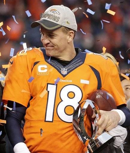Denver Broncos quarterback Peyton Manning holds the AFC Championship trophy  following the NFL football AFC Championship 9ef01a2fb