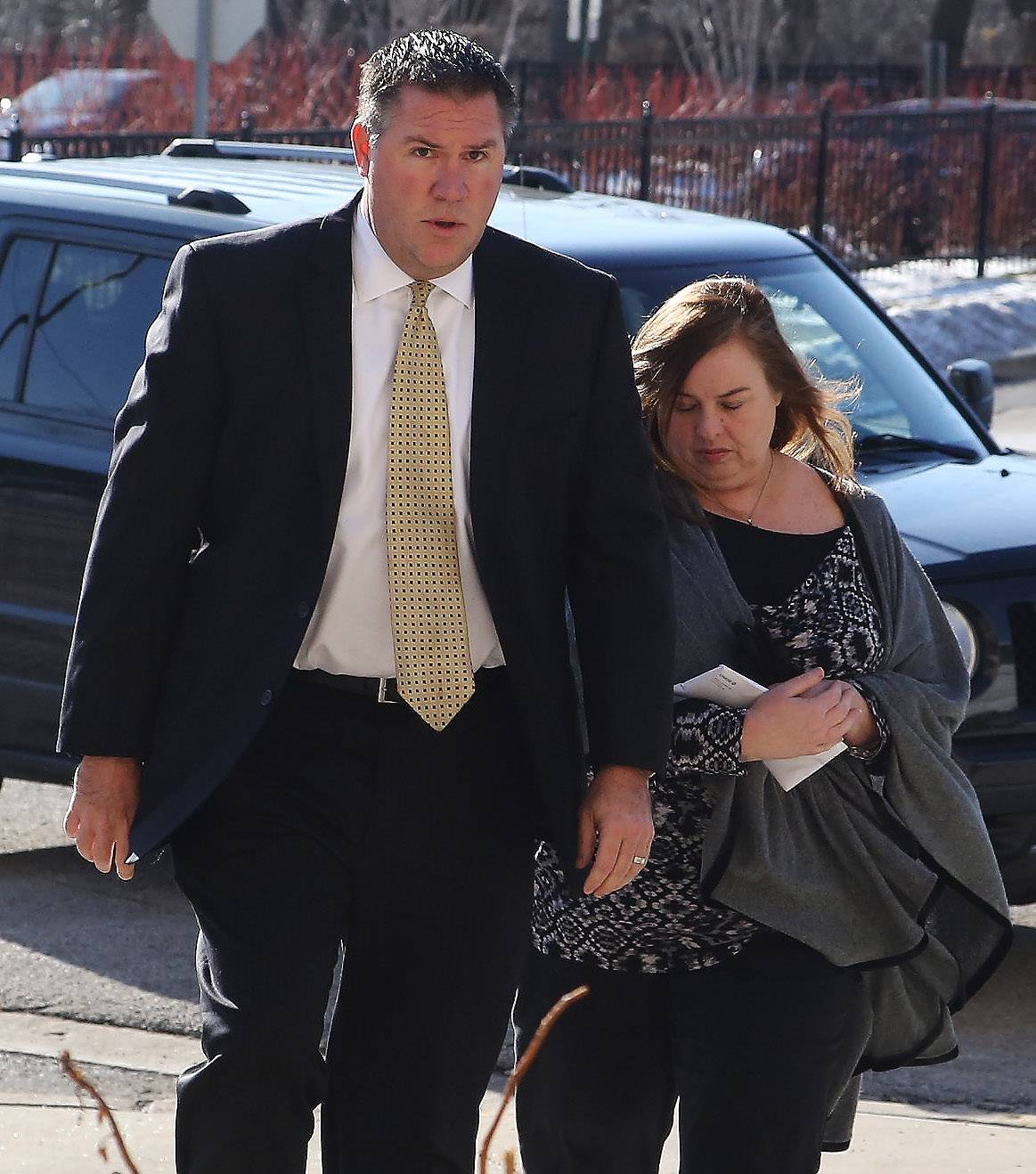 Melodie Gliniewicz walks into the Lake County sheriff's office with her attorney, Donald Morrison, after she was indicted by a grand jury Wednesday in Waukegan.