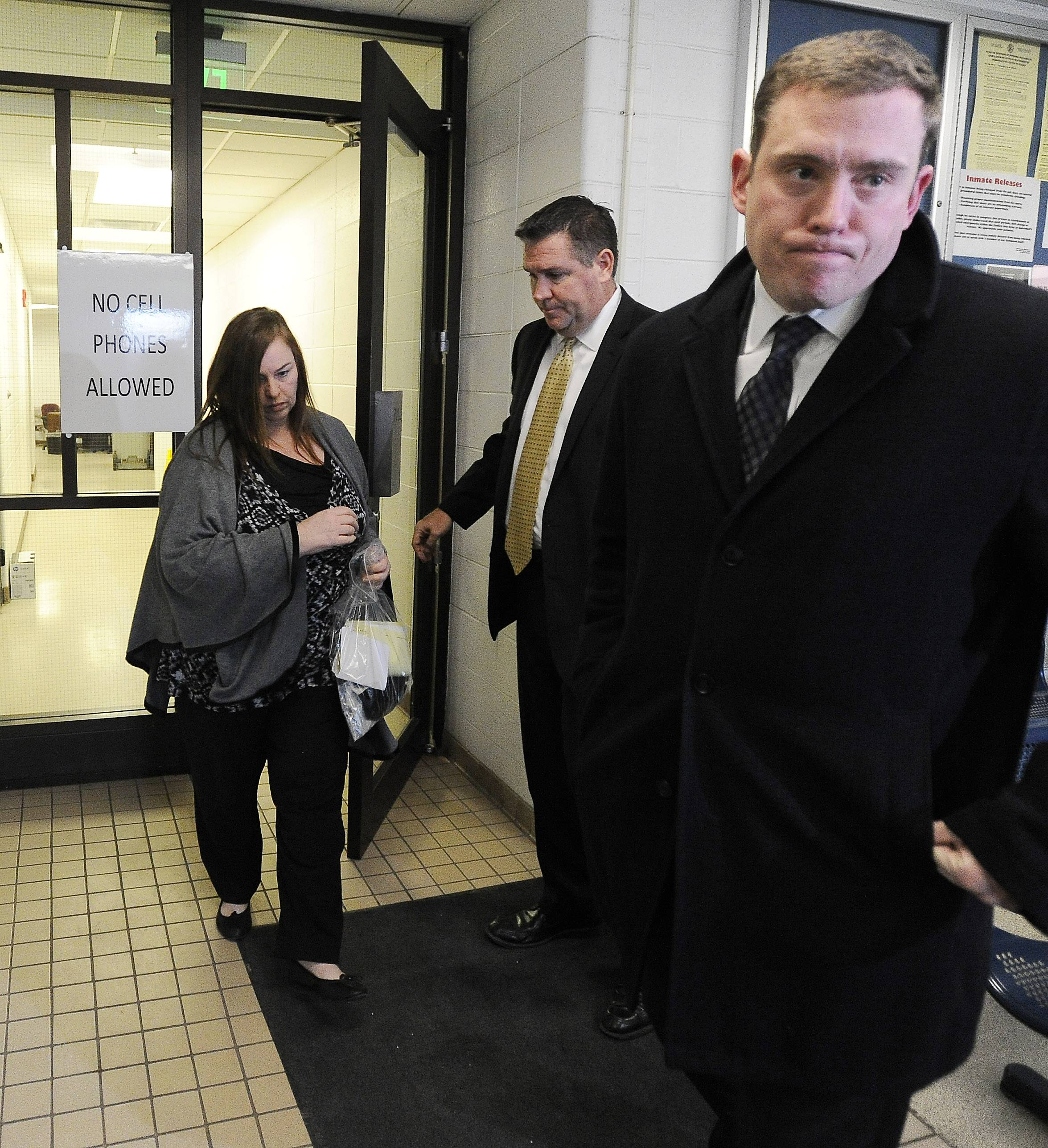 Melodie Gliniewicz is greeted by her lawyer after posting bail Wednesday at the Lake County sheriff's office in Waukegan.