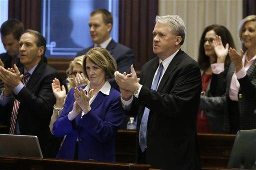 Illinois House Minority Leader Jim Durkin, R-Western Springs, right, and Illinois Senate Minority Leader Christine Radogno, R-Lemont, left, along with other Republicans applaud Illinois Gov. Bruce Rauner as he delivers his State of the State address to a joint session of the General Assembly in the House chambers at the Illinois State Capitol Wednesday, Jan. 27, 2016, in Springfield, Ill.