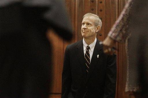 Illinois Gov. Bruce Rauner waits to be announced before delivering his State of the State address to a joint session of the General Assembly in the House chambers at the State Capitol on Wednesday, Jan. 27, 2016, in Springfield, Ill.