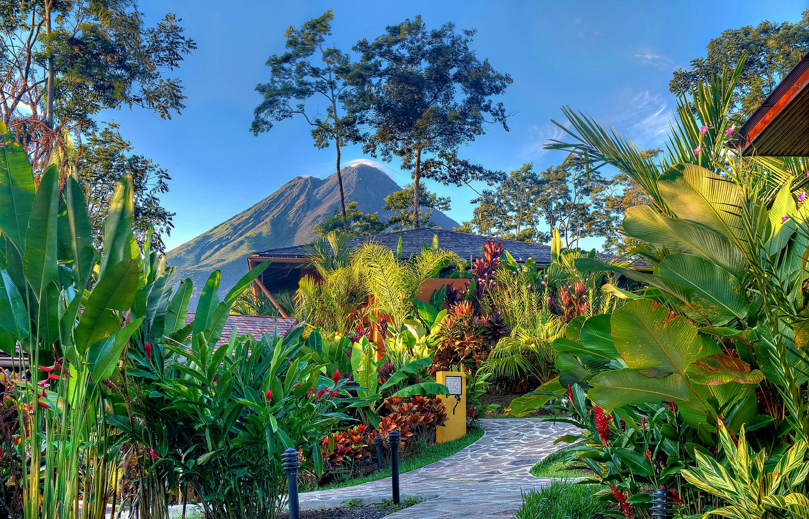 Costa Rica's Arenal Volcano forms a backdrop for Nayara Springs, rated the nation's No. 1 resort by two travel magazines.