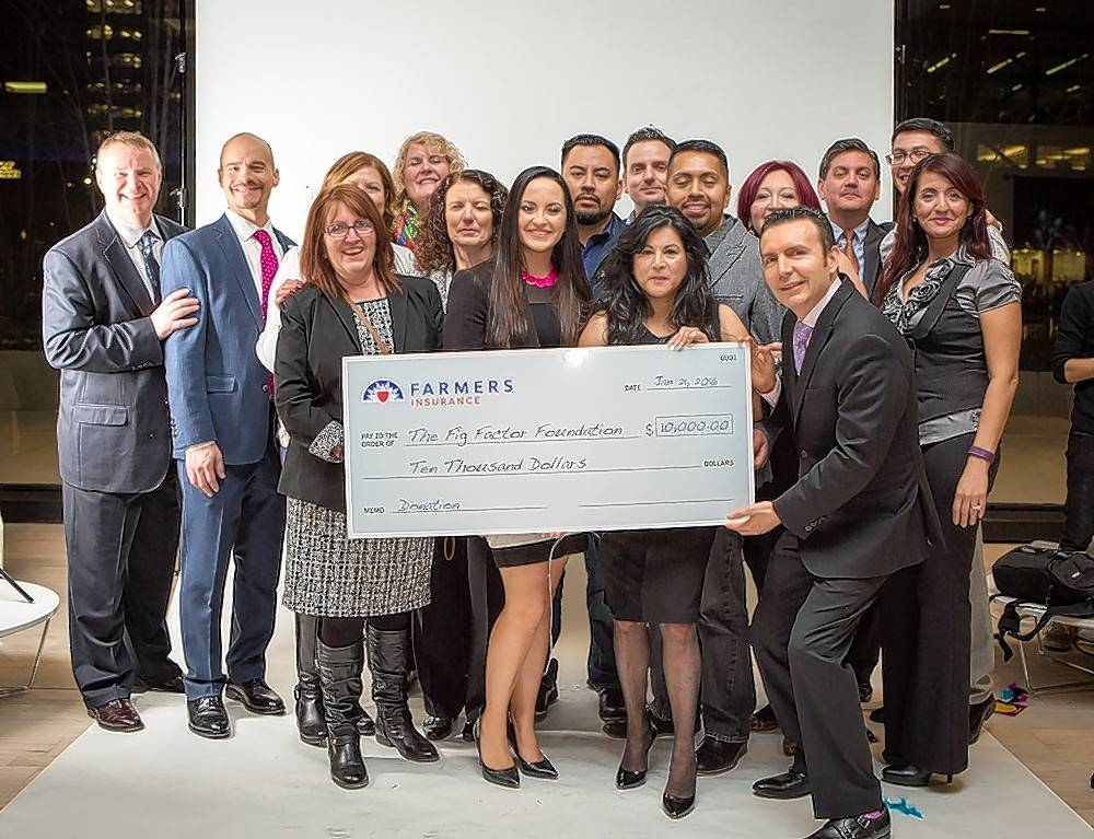 Surrounded by local agents and representatives, Jacqueline Camacho-Ruiz, center, accepts this $10,000 check from Farmers Insurance during the Fig Factor Foundation official launch and fundraiser Jan. 21 at Plante Moran in Chicago.
