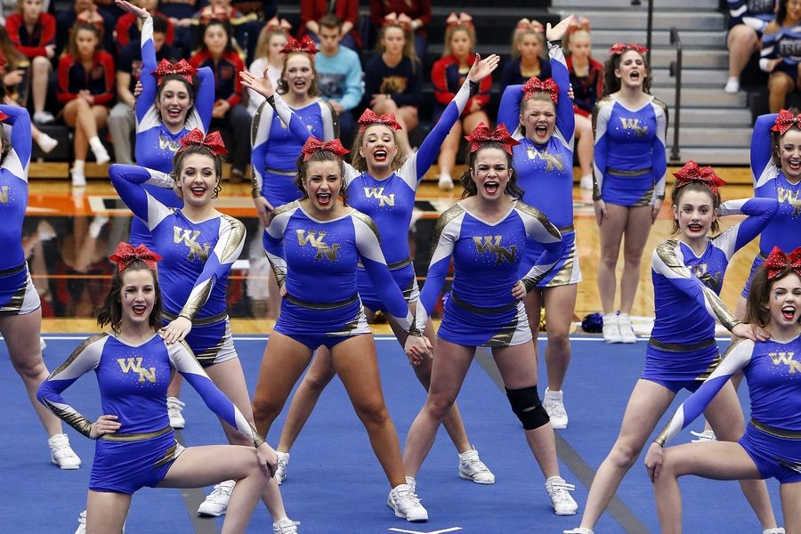 Brian Hill/bhill@dailyherald.comWheaton North competes Saturday during the IHSA sectional cheerleading competition in DeKalb.