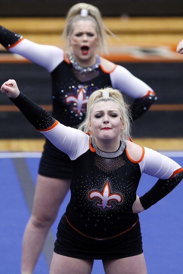 Brian Hill/bhill@dailyherald.comSt. Charles East competes Saturday during the IHSA sectional cheerleading competition in DeKalb.