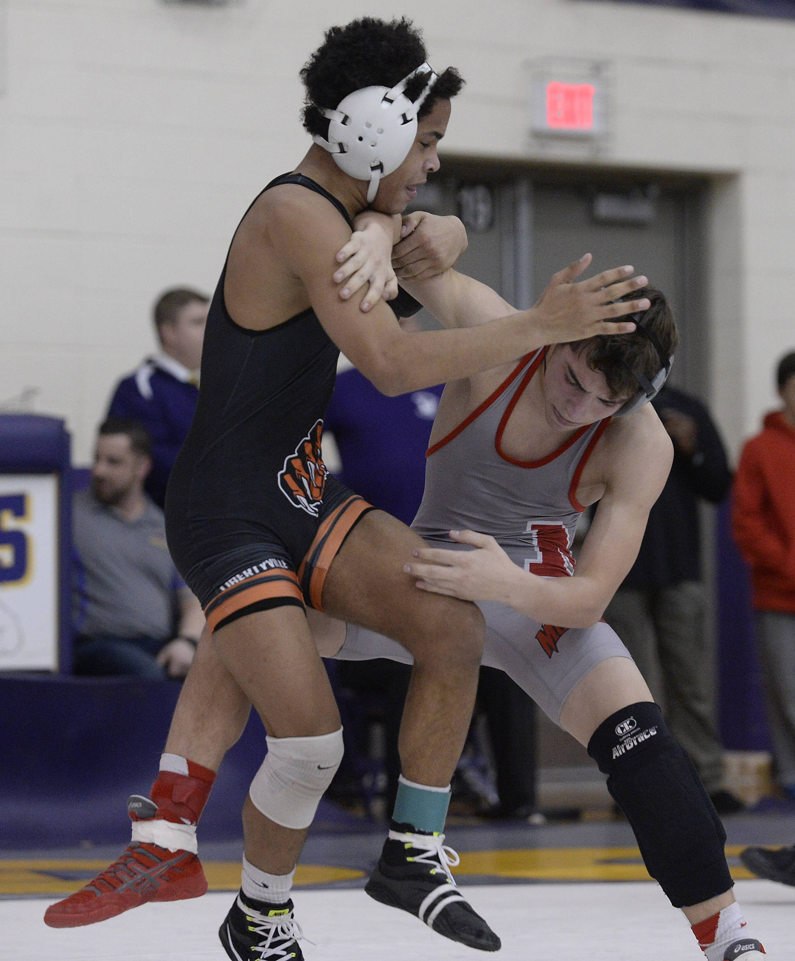 Alex Mitchell of Libertyville, left,  battles Dane Durlacher of Mundelein for the win at 106 pounds during the North Suburban Conference tournament in Wauconda on Saturday.