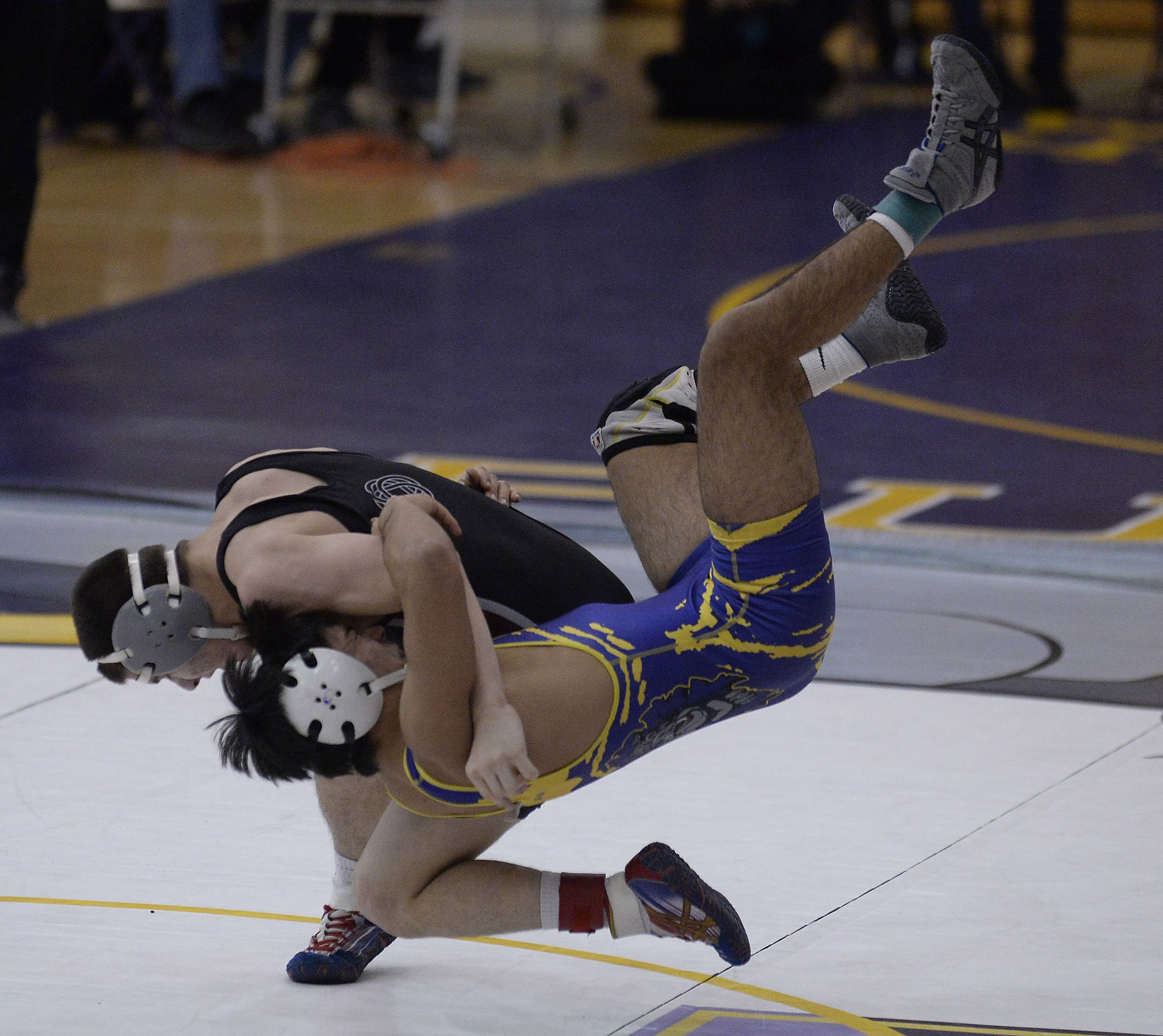 Wauconda's Jose Munoz is taken to the mat by Nathan Dlugopolski of Antioch in their 126-pound matchup on Saturday during the North Suburban Conference tournament finals at Wauconda.