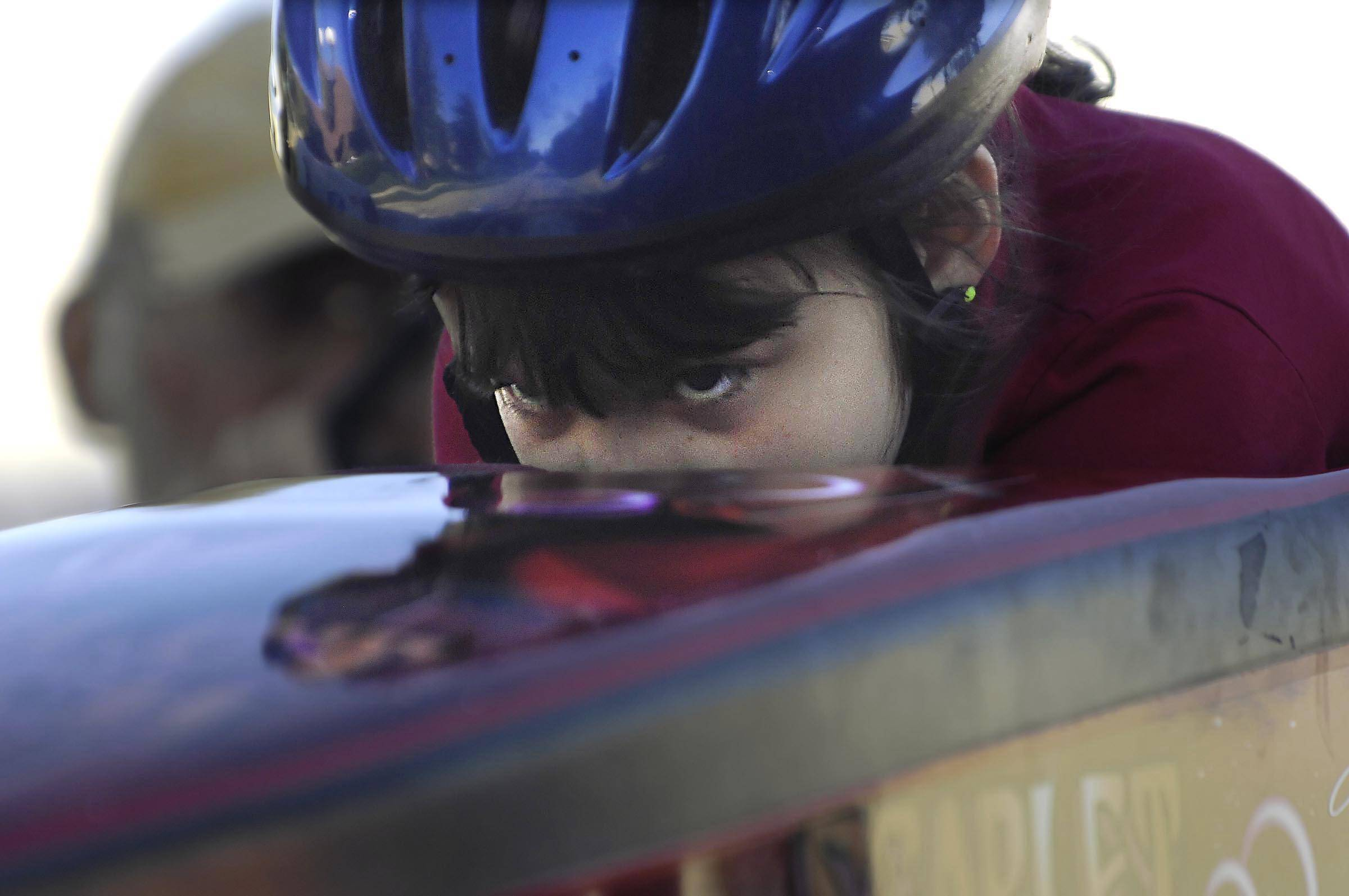 Ava McCollim, 8, of South Elgin has flourished as a soap box derby racer. It has helped her focus and control her health and developmental issues, which include epileptic seizures and autism, according to her mother, Heather. Ava likes how the small car holds her tight, making her feel like a baby that's been swaddled.