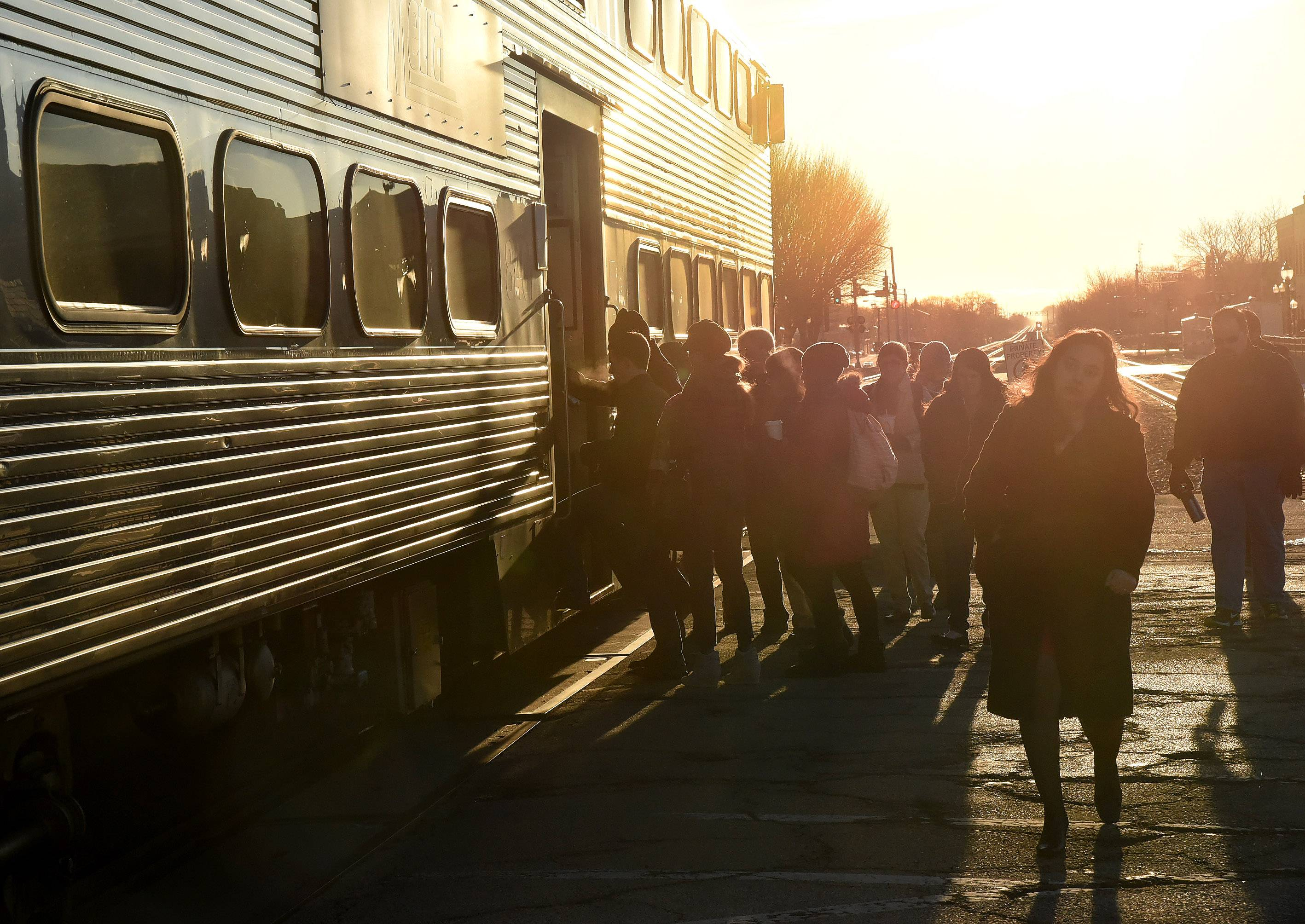 Commuters board Metra Union Pacific Northwest Line train at the Arlington Heights station.