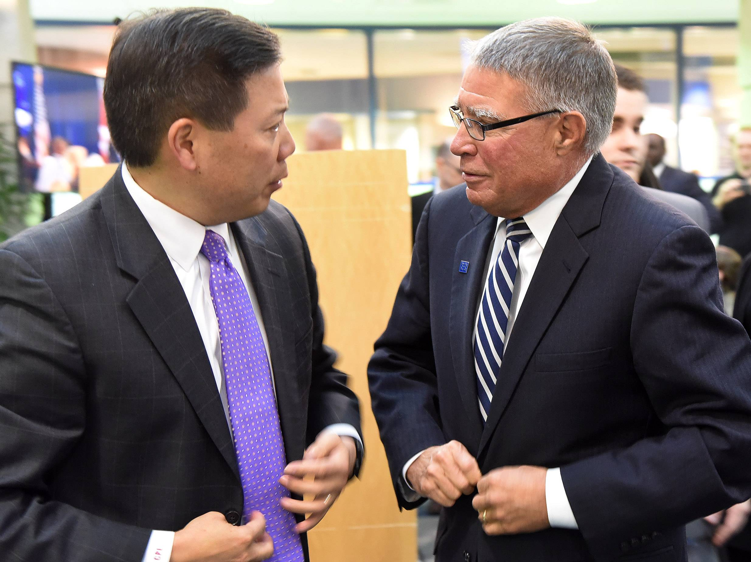 U.S. Deputy Secretary of Labor Chris Lu and Harper College President Kenneth Ender talk Tuesday after an event to launch a first-of-its-kind apprenticeship program between the Palatine school and Schaumburg-based Zurich North America.
