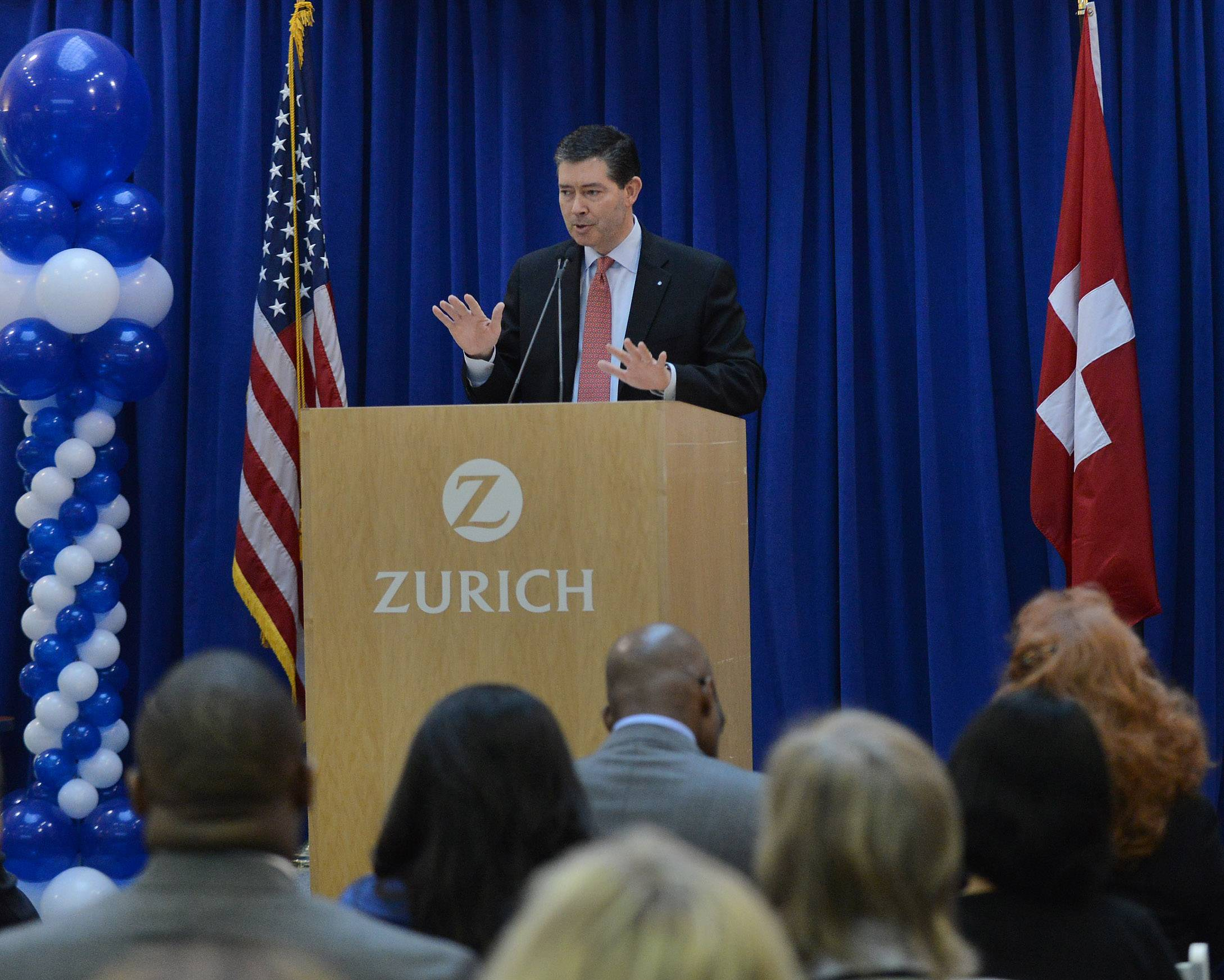 Mike Foley, chief executive officer of Zurich North America Commercial, addresses the crowd Tuesday as he helps launch a new apprenticeship program for the insurance industry between Zurich and Harper College.