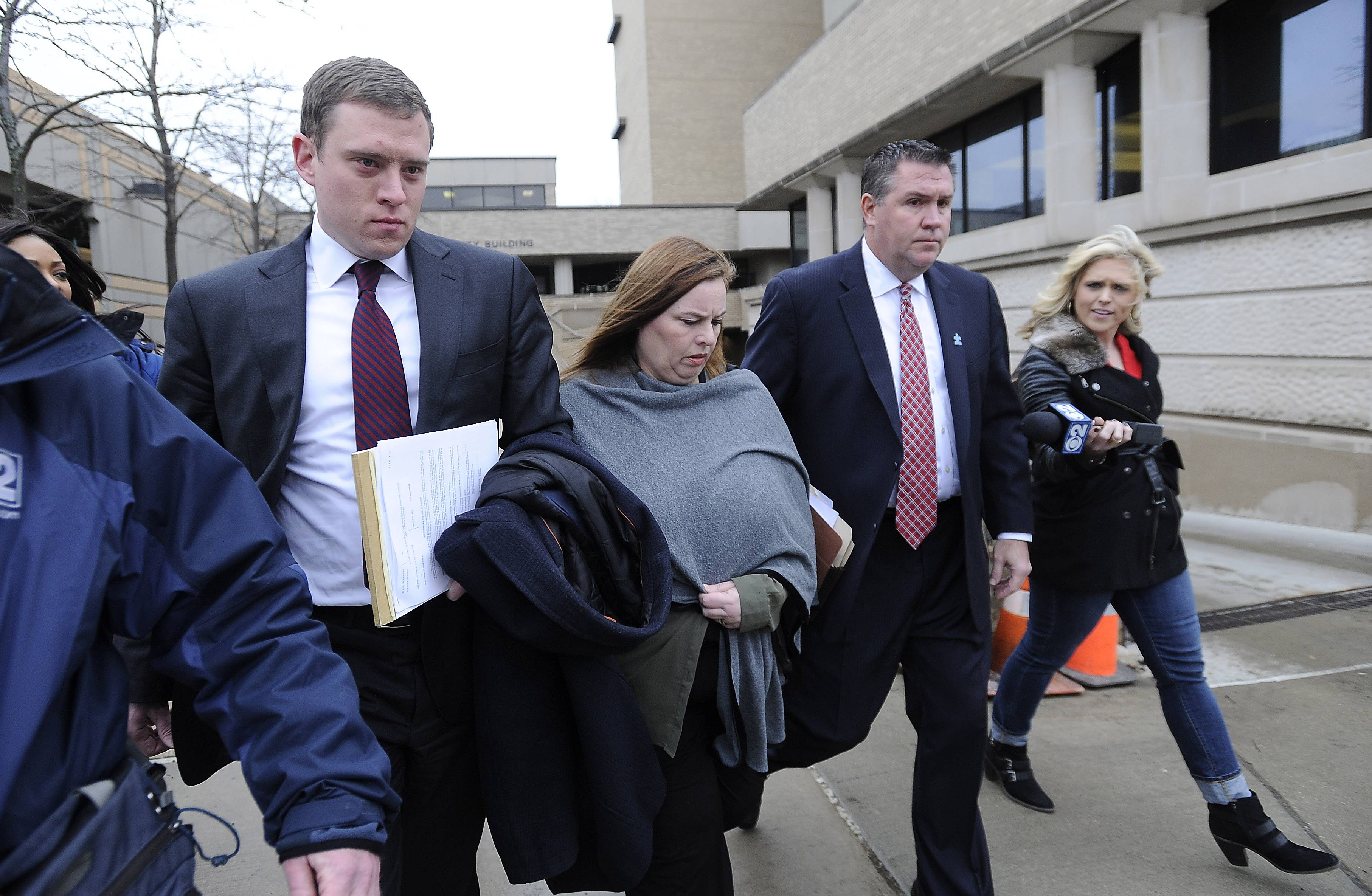 Melodie Gliniewicz and her lawyers leave the Lake County Courthouse in Waukegan on Wednesday.
