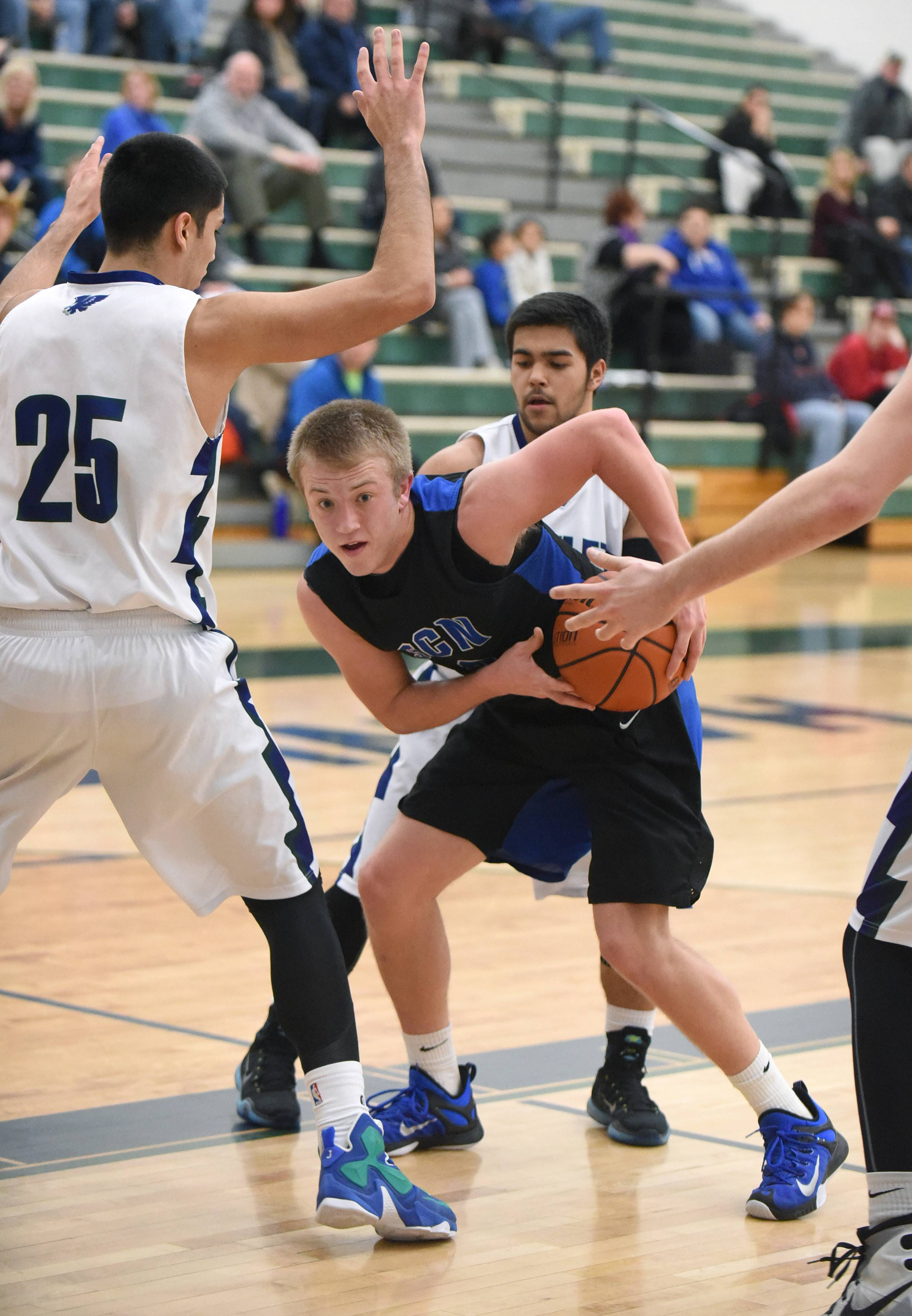 St. Charles North's Jake Spaniol looks to get past a screen by Bartlett's Robby Jimenez in the third quarter Wednesday.