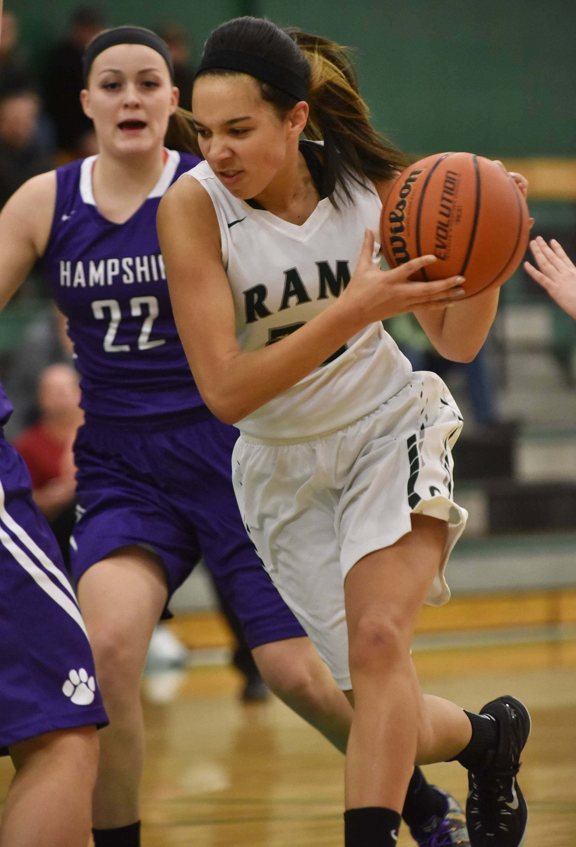 Grayslake Central's Ania Barnes drives around Hampshire's Emma Benoit Wednesday in Grayslake.