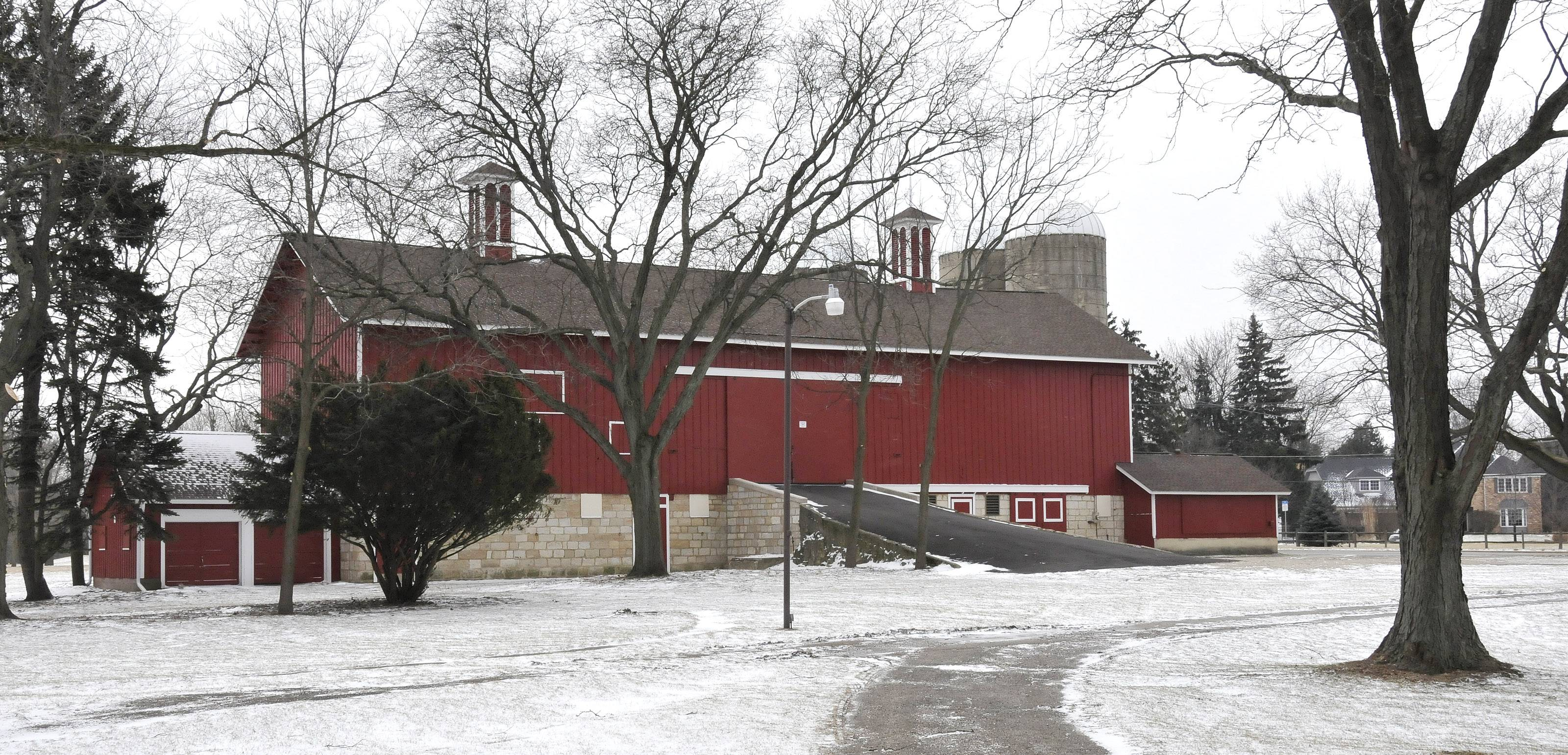 The candidates for the District 5 seat on the DuPage County Forest Preserve Commission both say they played key roles in preserving the Greene Farm Barn near Naperville.