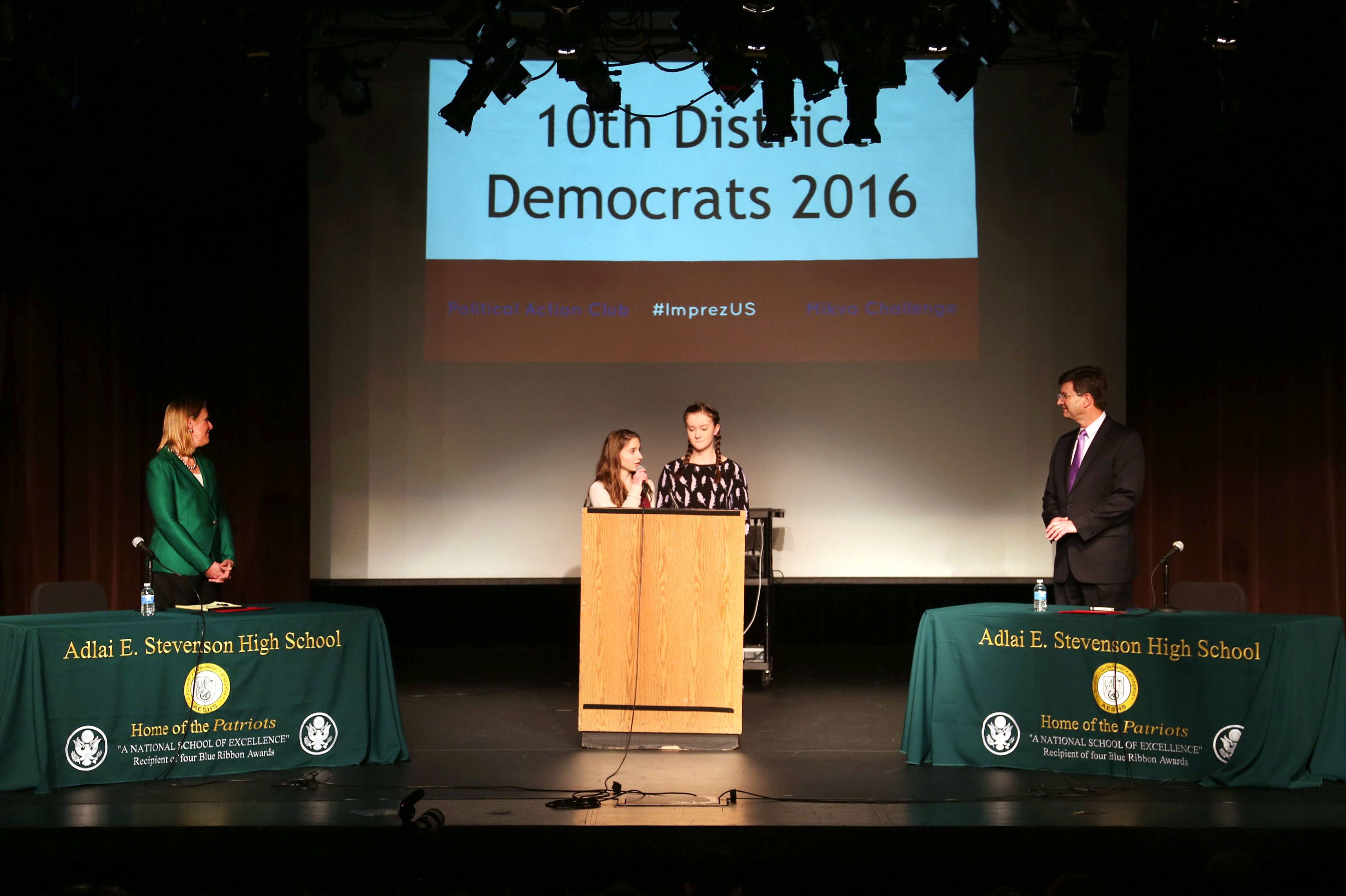 Nancy Rotering, left, and Brad Schneider, Democrats running for the 10th Congressional District seat, are introduced by student moderators Sophia Siegel, left, and Julia Ellis during a debate Wednesday at Stevenson High School in Lincolnshire.