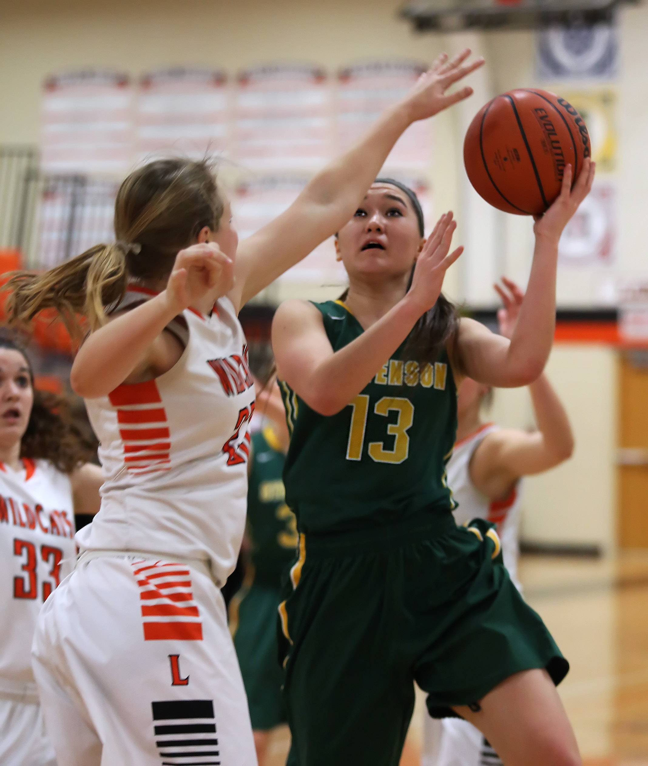 Stevenson guard Kiana Cencula goes up for a layup over Libertyville forward Sarah Pavelske.