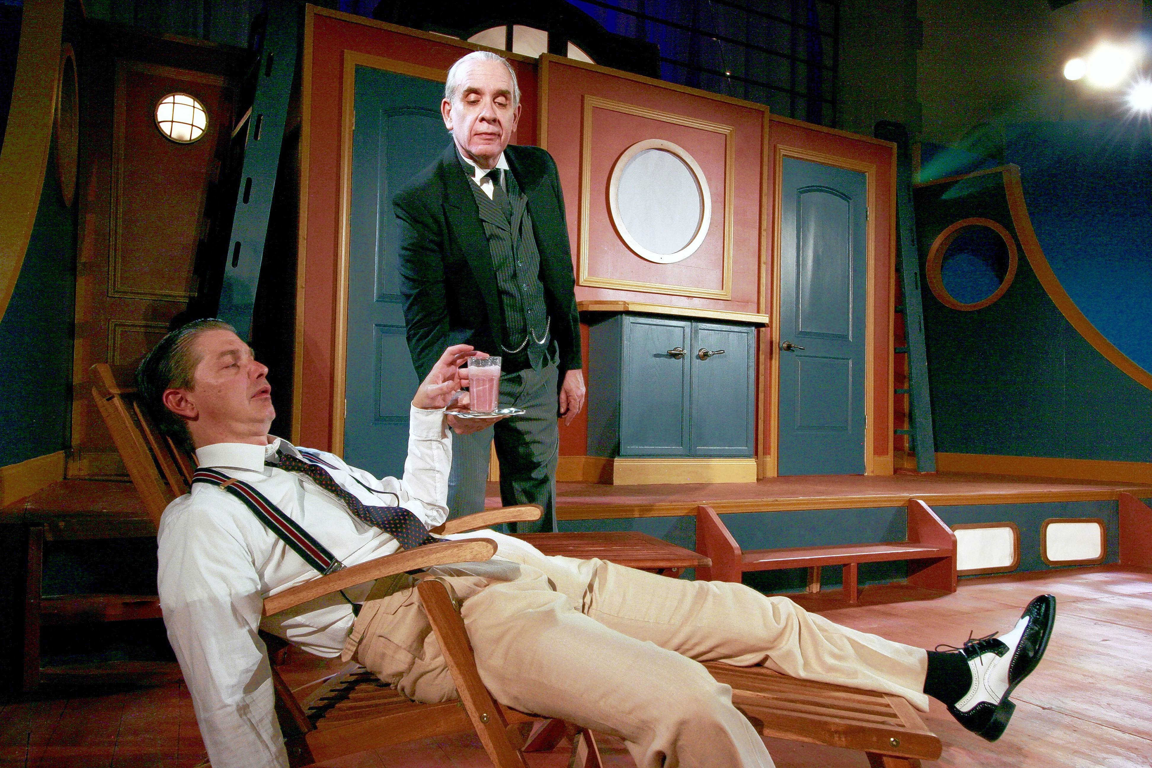 "Jeeves (Jim McCance), right, attends to a hung-over Bertie (Christian Gray) in First Folio Theatre's latest P.G. Wodehouse adaptation, ""Jeeves at Sea,"" by Margaret Raether."