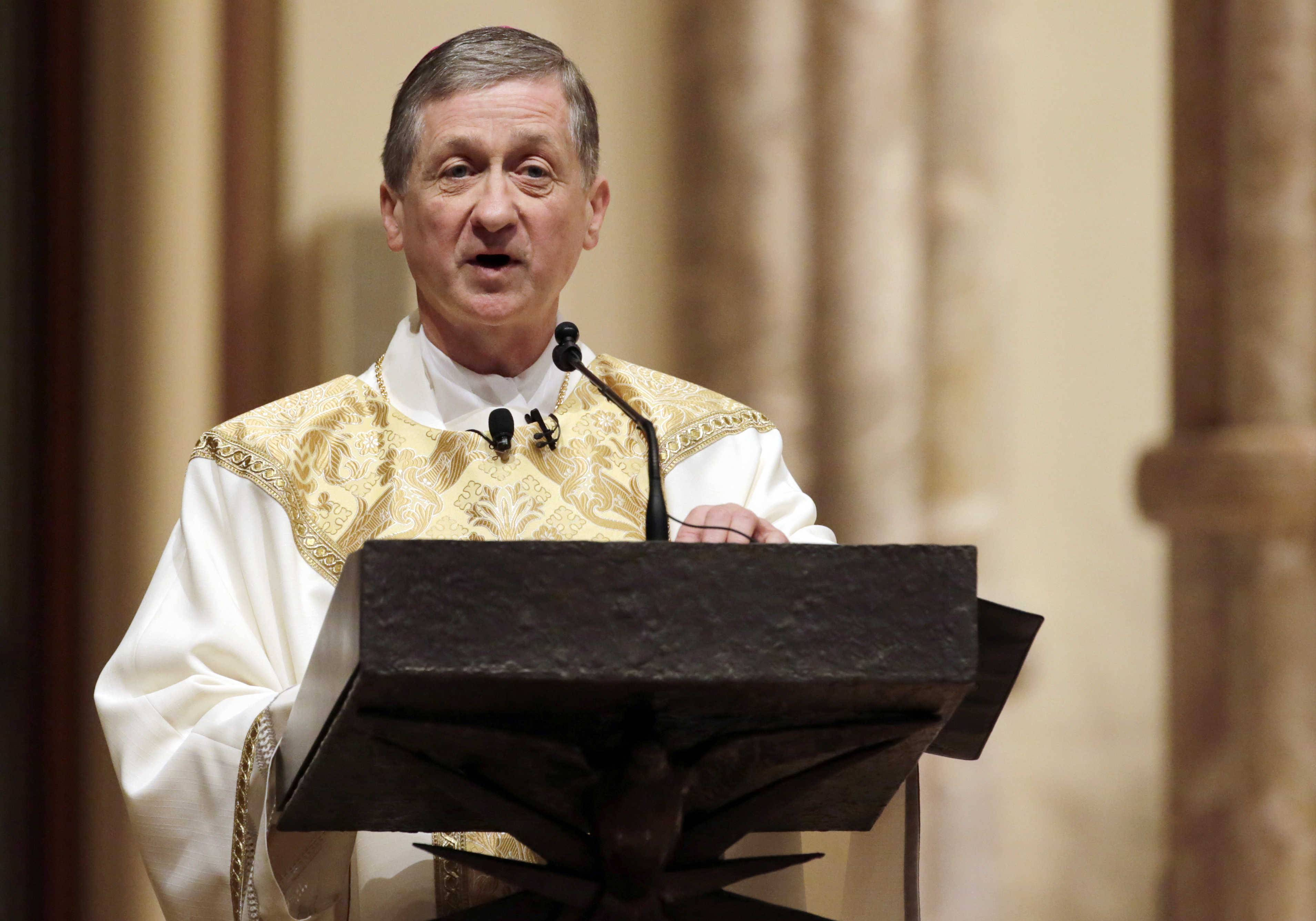 Archbishop Blase Cupich delivers the homily during his Installation Mass at Holy Name Cathedral in November 2014. Cupich has announced a restructuring plan is underway for the nation's third-largest Catholic archdiocese, which is expected to include parish closures and consolidations.