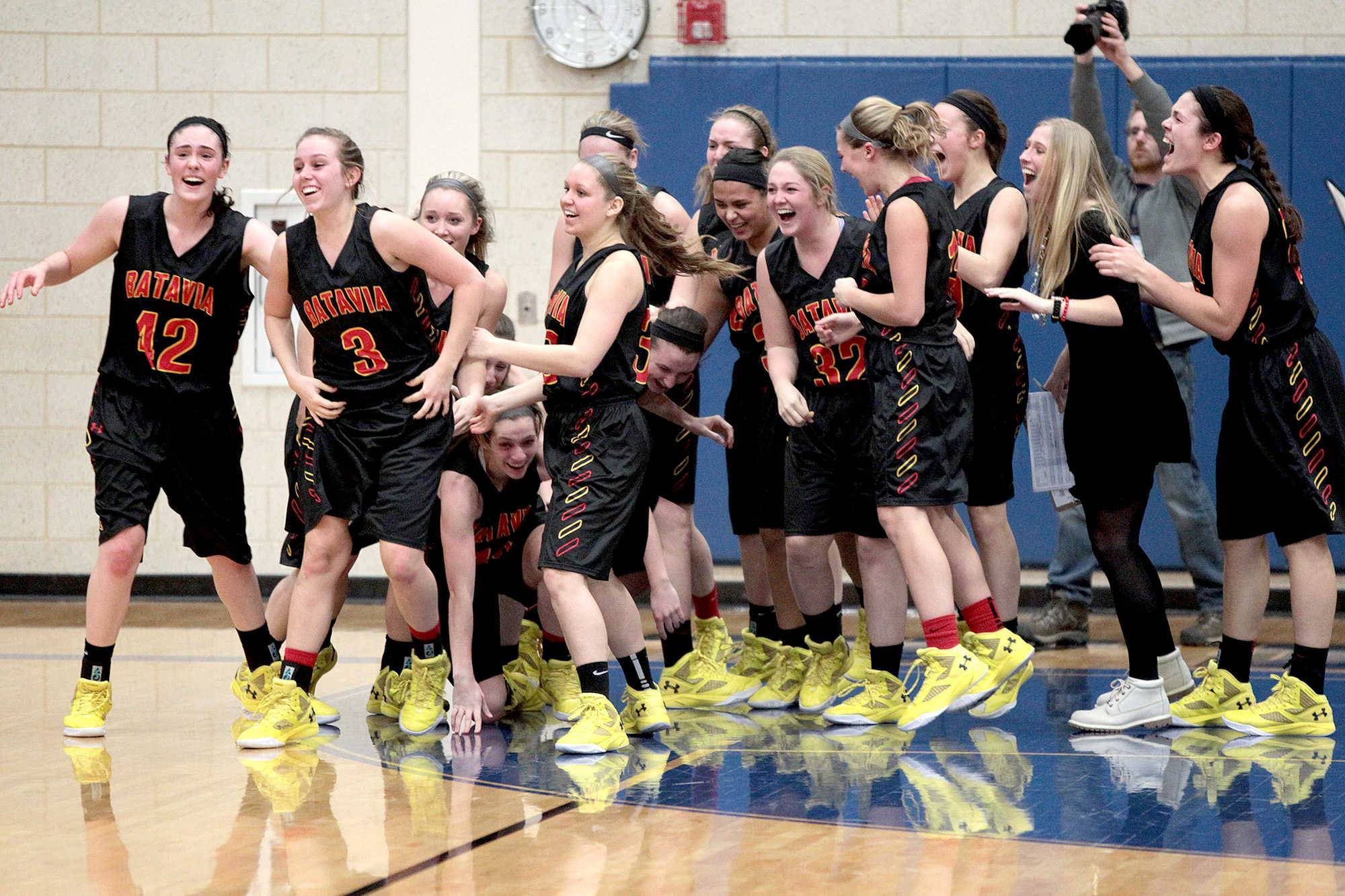 Batavia players celebrate a game-winning shot by Bethany Orman (3) that beat Geneva Friday.
