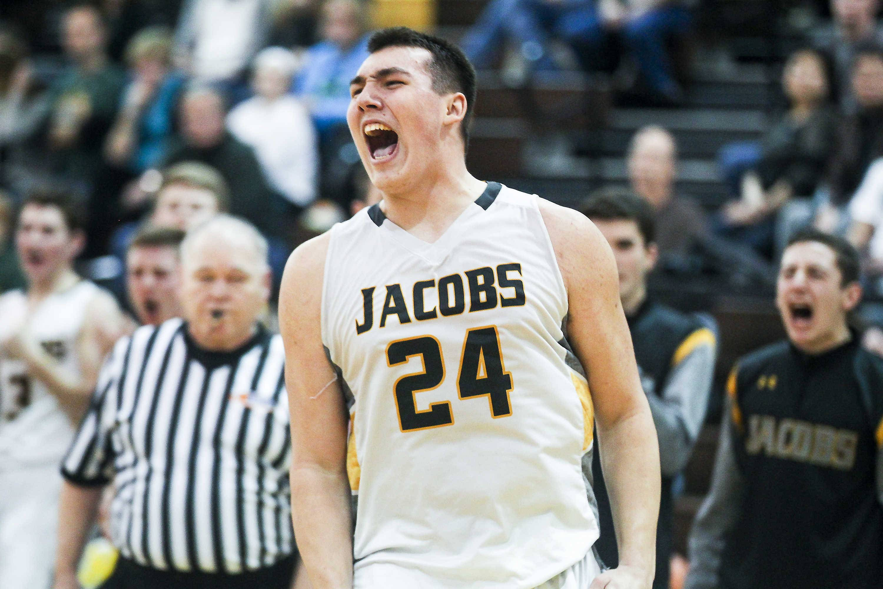 Jacobs' Cameron Krutwig celebrates after he was fouled during the fourth quarter of Friday's game against Crystal Lake South.