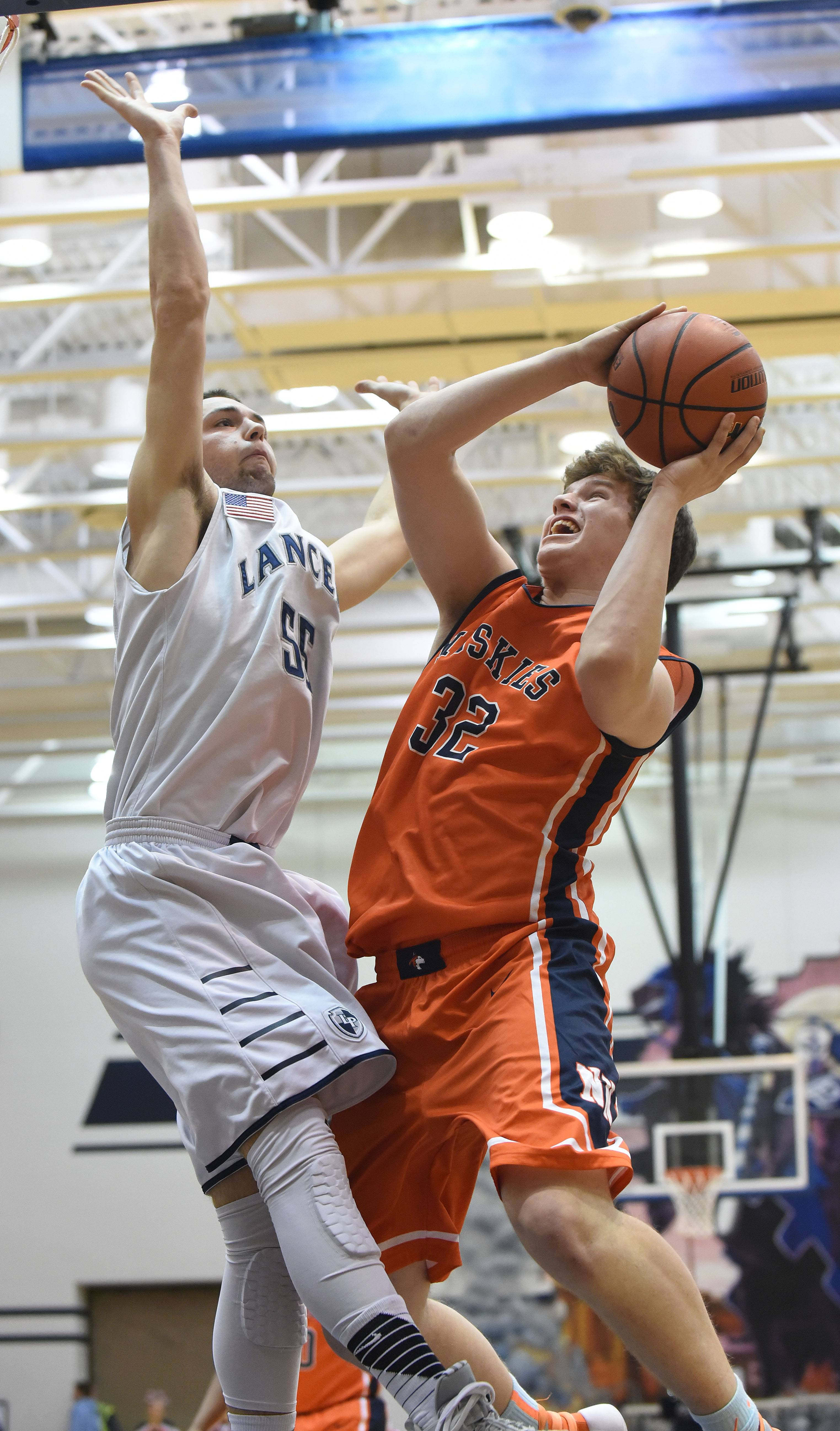 Mitchell Jarosinski of Lake Park attempts to block Chris Johnson of Naperville North.