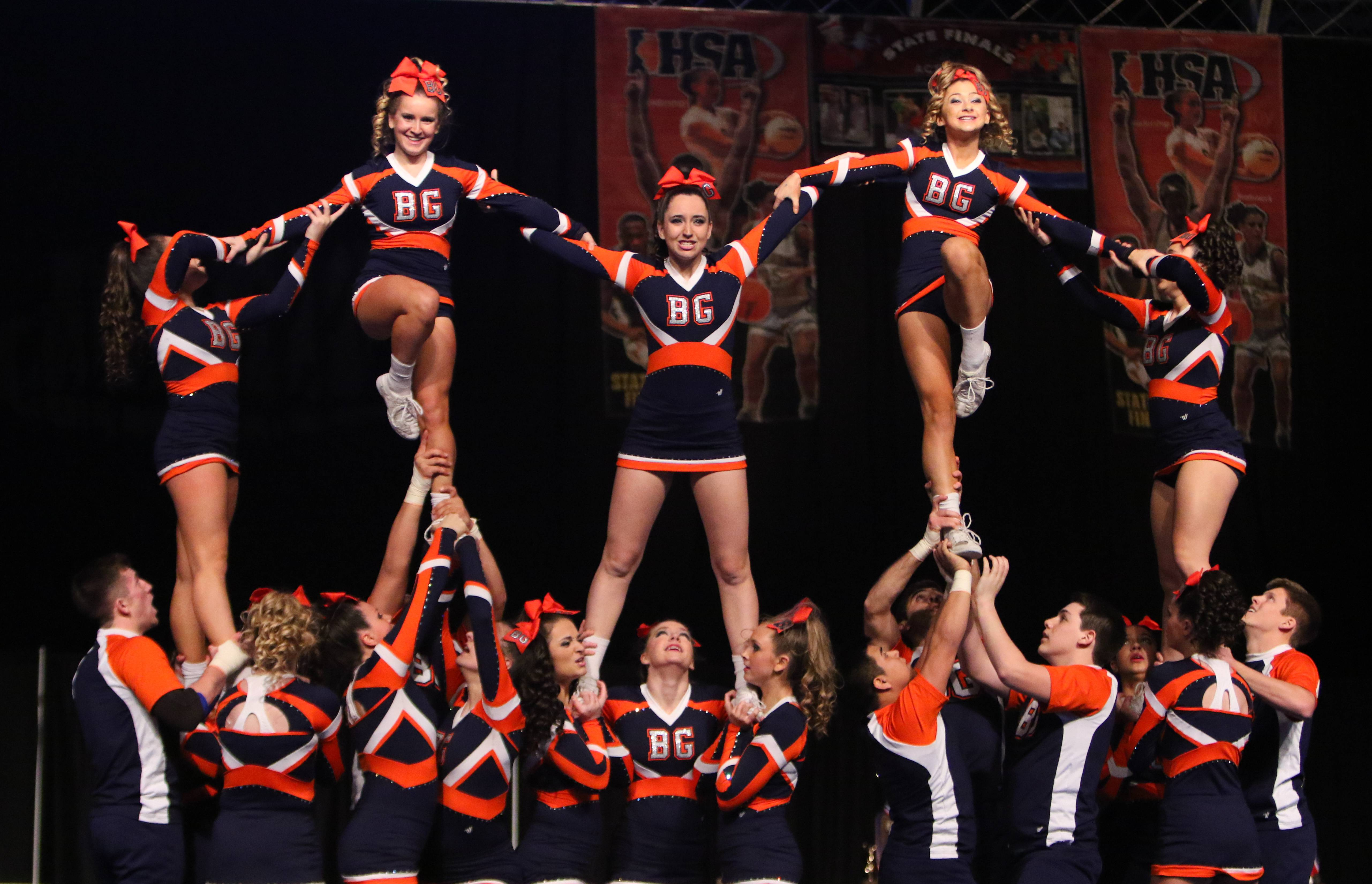 Buffalo Grove High School's coed squad competes during Friday's preliminary round at the state cheerleading championships in Bloomington. Buffalo Grove advanced to Saturday's final with the best preliminary score in its division..