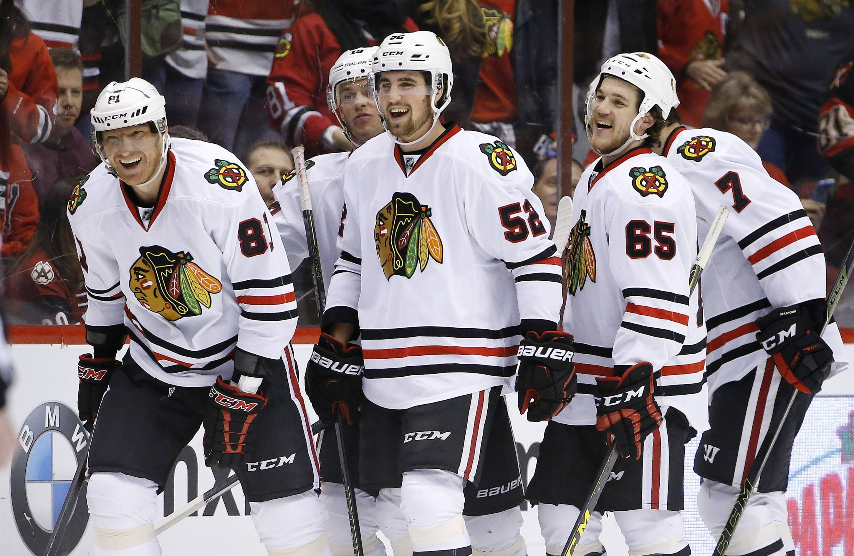 Chicago Blackhawks' Marian Hossa (81), of the Czech Republic, smiles as he celebrates his goal against the Arizona Coyotes with teammates Erik Gustafsson (52), of Sweden, Andrew Shaw (65), Brent Seabrook (7) and Jonathan Toews during the second period of an NHL hockey game Thursday, Feb. 4, 2016, in Glendale, Ariz. (AP Photo/Ross D. Franklin)
