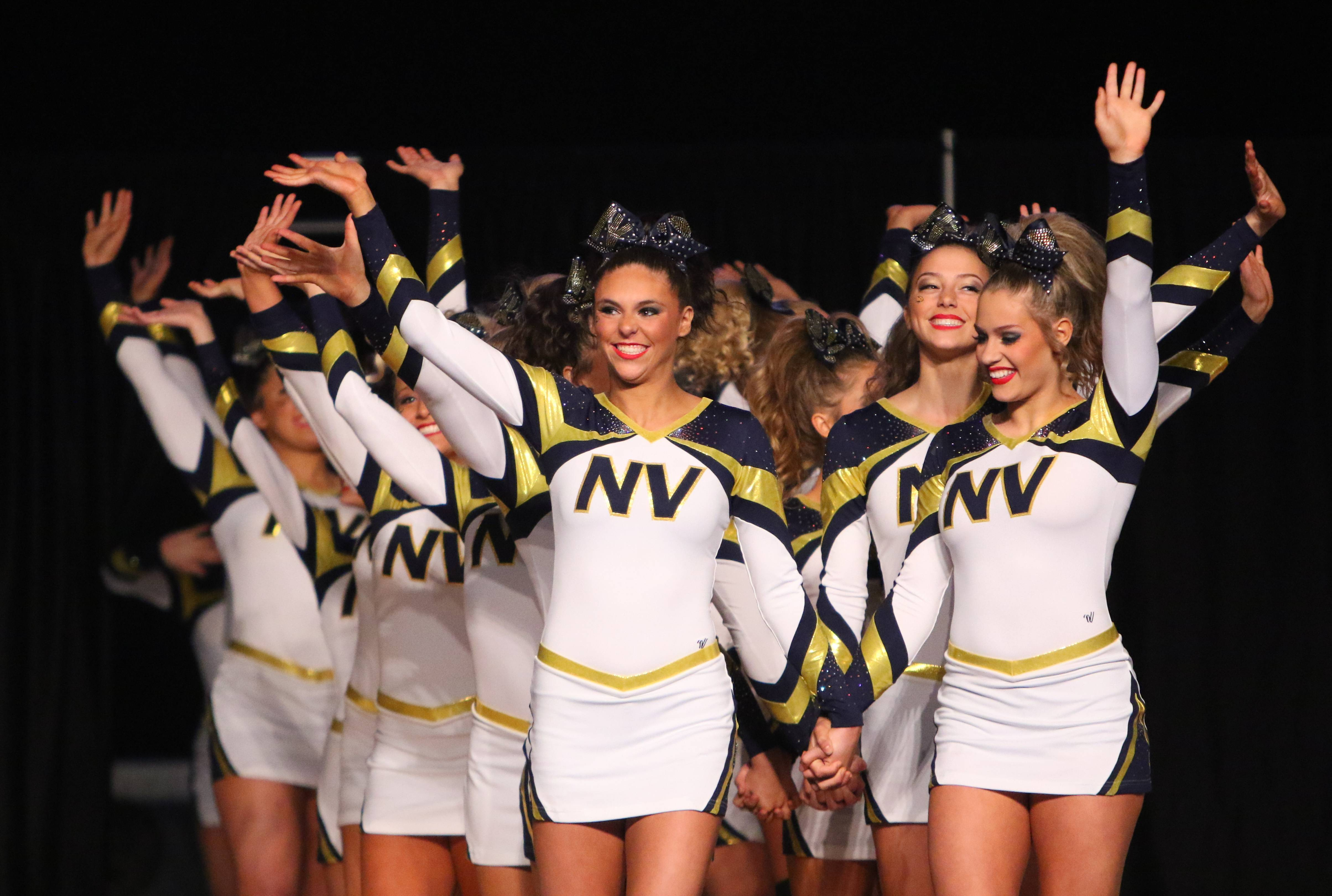 Neuqua Valley's cheerleaders perform Friday at the state meet in Bloomington. Neuqua advanced in the large team division.