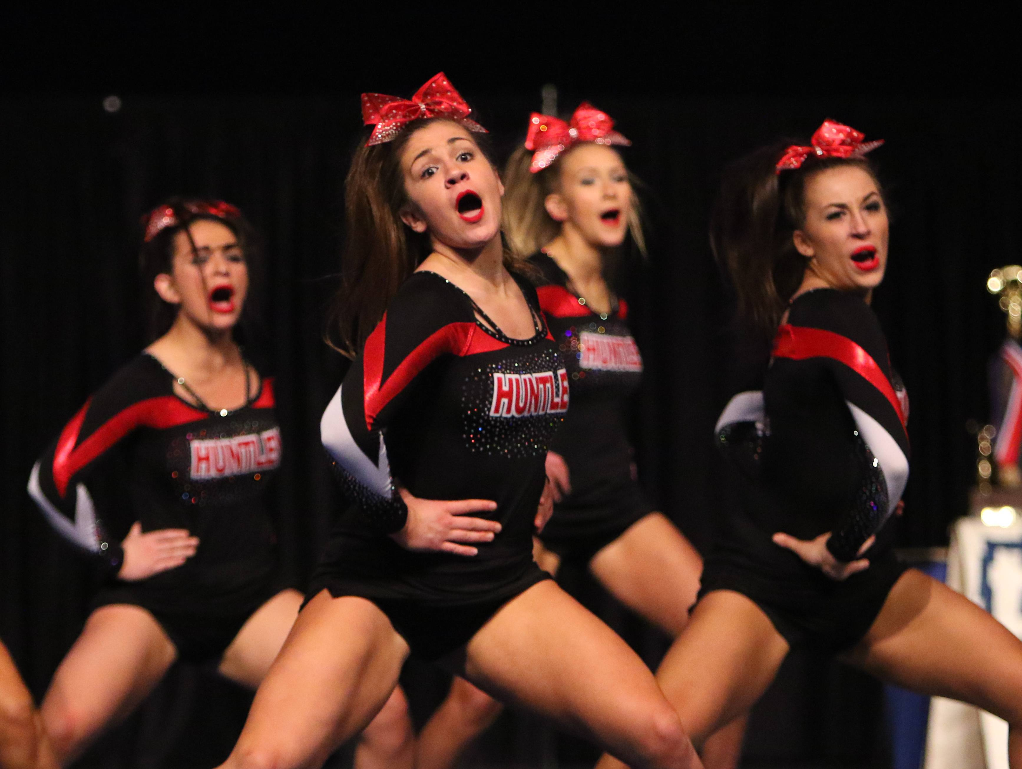 Huntley High School competes during the state cheerleading prelims in Bloomington. Huntley finished in the top 10 Friday, securing a berth in Saturday's final round.