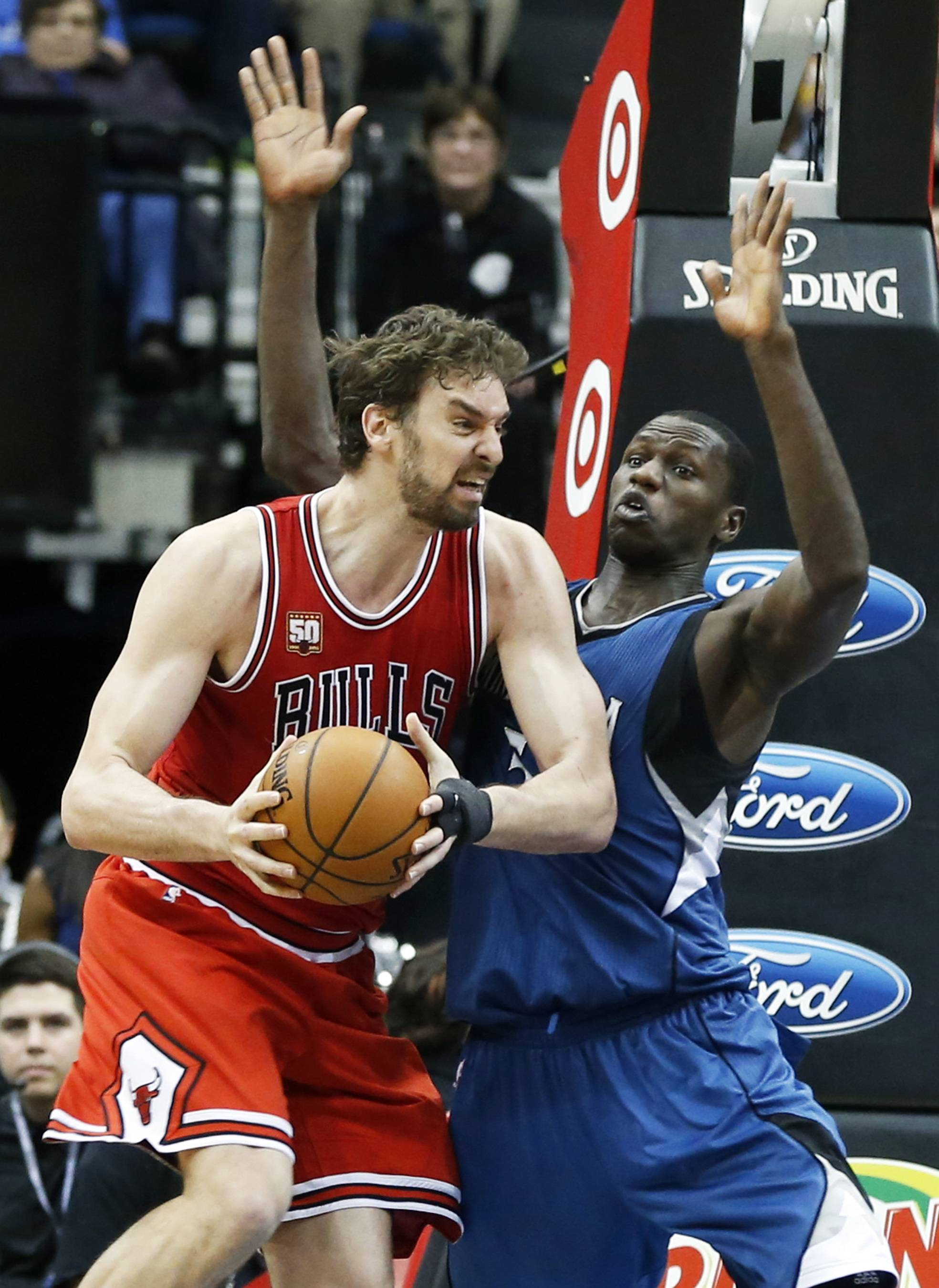 Chicago Bulls' Pau Gasol, left, of Spain, tries to work around Minnesota Timberwolves' Gorgui Dieng of Senegal in the second half of an NBA basketball game, Saturday, Feb. 6, 2016, in Minneapolis. The Timberwolves won 112-105. Gasol led the Bulls with 25 points while Dieng scored 24 for the Timberwolves. (AP Photo/Jim Mone)