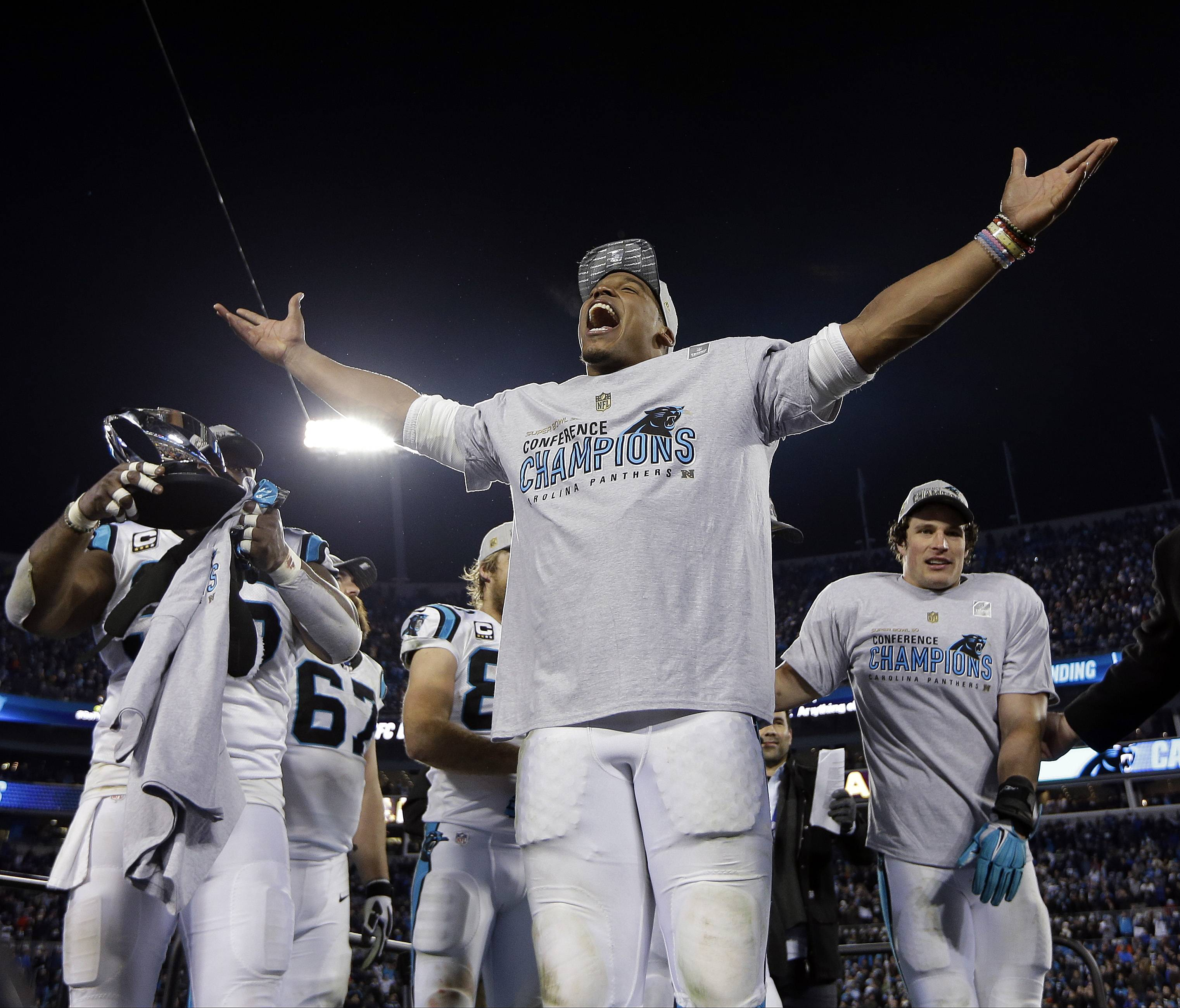 FILE - In this Jan. 24, 2016 file photo, Carolina Panthers' Cam Newton celebrates after the NFL football NFC championship game against the Arizona Cardinals in Charlotte, N.C. Newton is wearing Lokai silicone bead bracelets with a bit of water from Mount Everest in one of the beads and a dab of mud from the Dead Sea in another, aimed at achieving the lofty goal of inner balance by honoring the highs and lows of life. (AP Photo/David J. Phillip, File)