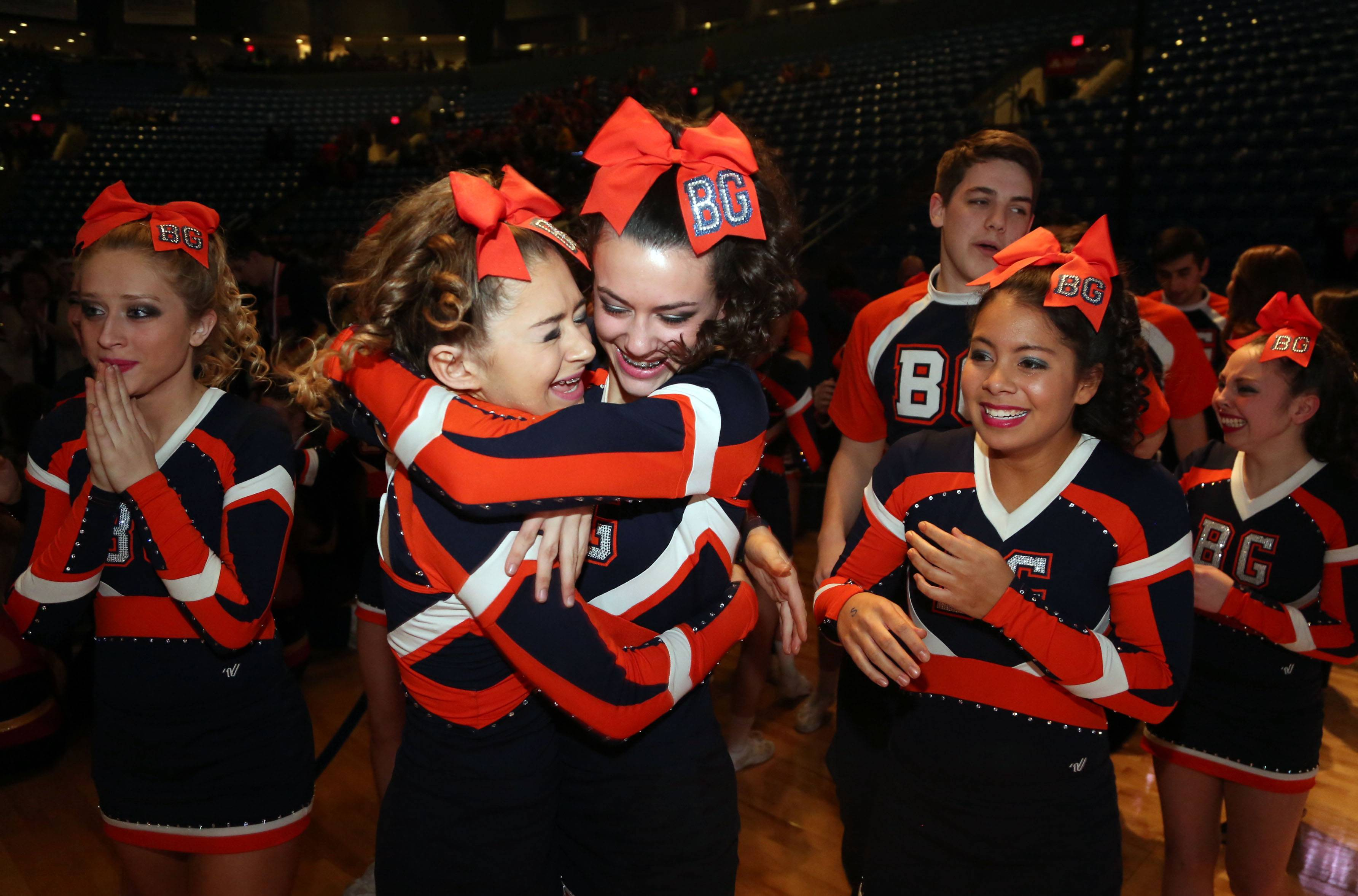 Buffalo Grove High School's squad celebrates after winning first place in the coed division during the state cheerleading finals Saturday in Bloomington.