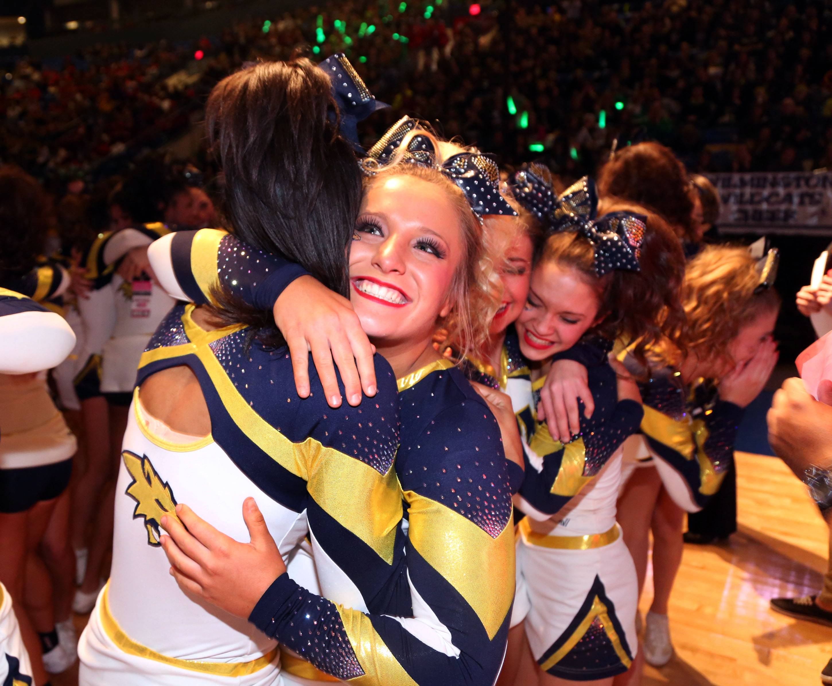 Neuqua Valley's Peaches Caldwell and Mandi Banyai celebrate after winning third place in the large school division at state cheerleading finals Saturday in Bloomington.