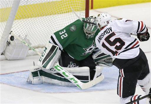 Chicago Blackhawks center Artem Anisimov (15) scores a goal against Dallas Stars goalie Kari Lehtonen (32) during the second period of an NHL hockey game Saturday, Feb. 6, 2016, in Dallas. (AP Photo/LM Otero)