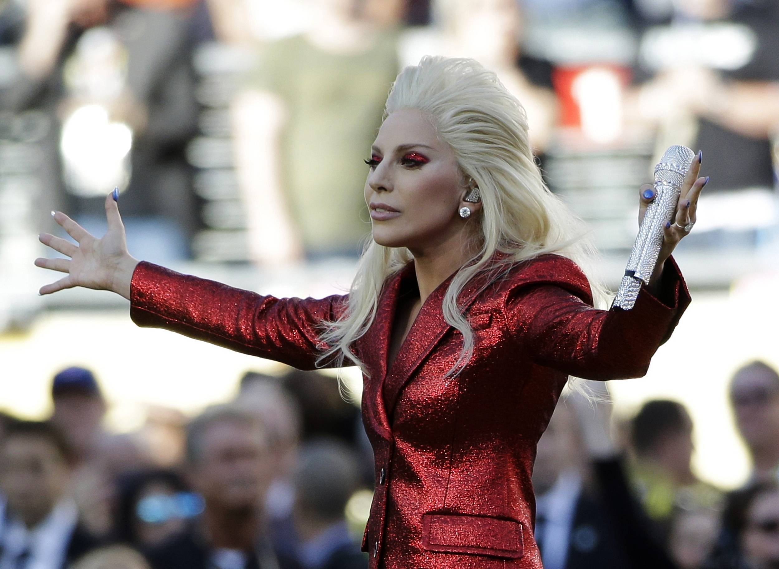 Lady Gaga sings the national anthem before the NFL Super Bowl 50 football game between the Denver Broncos and the Carolina Panthers Sunday in Santa Clara, Calif.