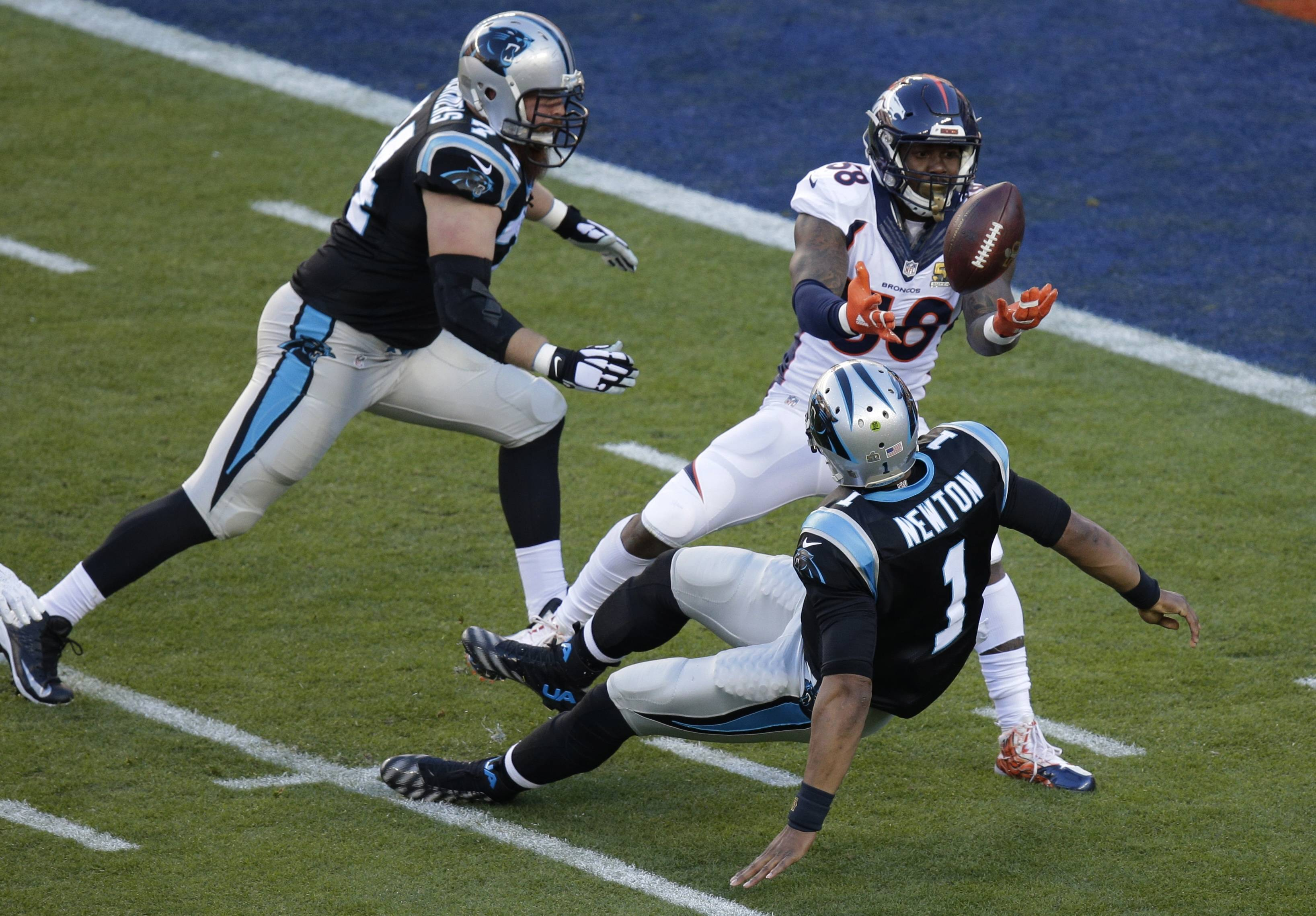 Denver linebacker Von Miller strips the ball from Carolina QB Cam Newton during the first half of Super Bowl 50. The Broncos recovered the ball for a touchdown.