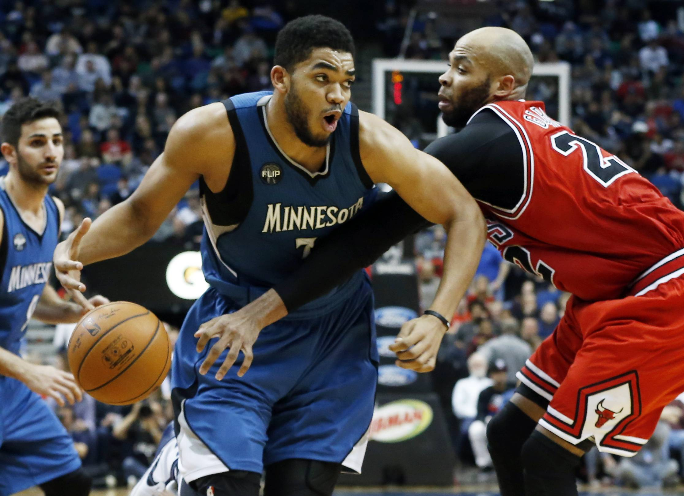 Minnesota Timberwolves' Karl-Anthony Towns, left, drives on Chicago Bulls' Taj Gibson in the second half of an NBA basketball game, Saturday, Feb. 6, 2016, in Minneapolis. The Timberwolves won 112-105. (AP Photo/Jim Mone)