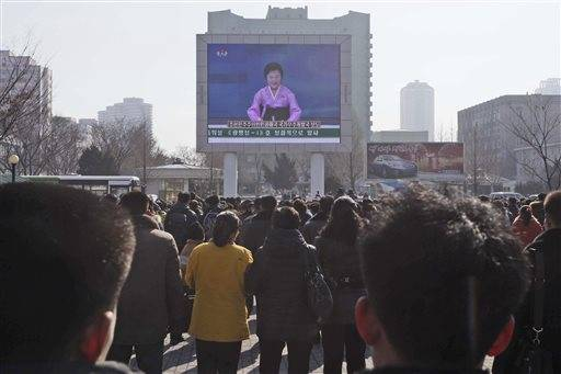 North Koreans watch an electronic screen announcing the launch of a satellite on Sunday, Feb. 7, 2016, at the Pyongyang Railway Station in Pyongyang, North Korea. North Korea on Sunday defied international warnings and launched a long-range rocket that the United Nations and others call a cover for a banned test of technology for a missile that could strike the U.S. mainland. (AP Photo/Kim Kwang Hyon)