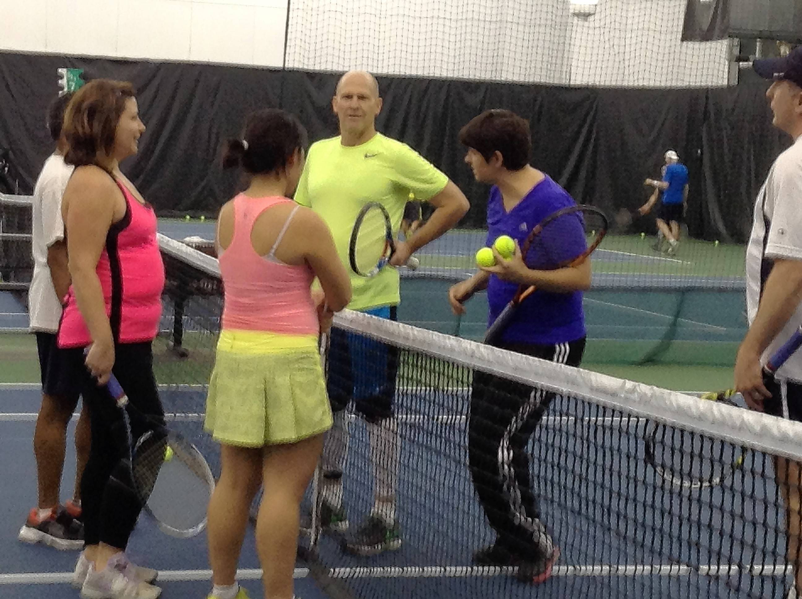 Teacher Krisztina Anderko (in blue) explains the next drill to a Cardio Tennis class at Midtown Athletic Club in Palatine.