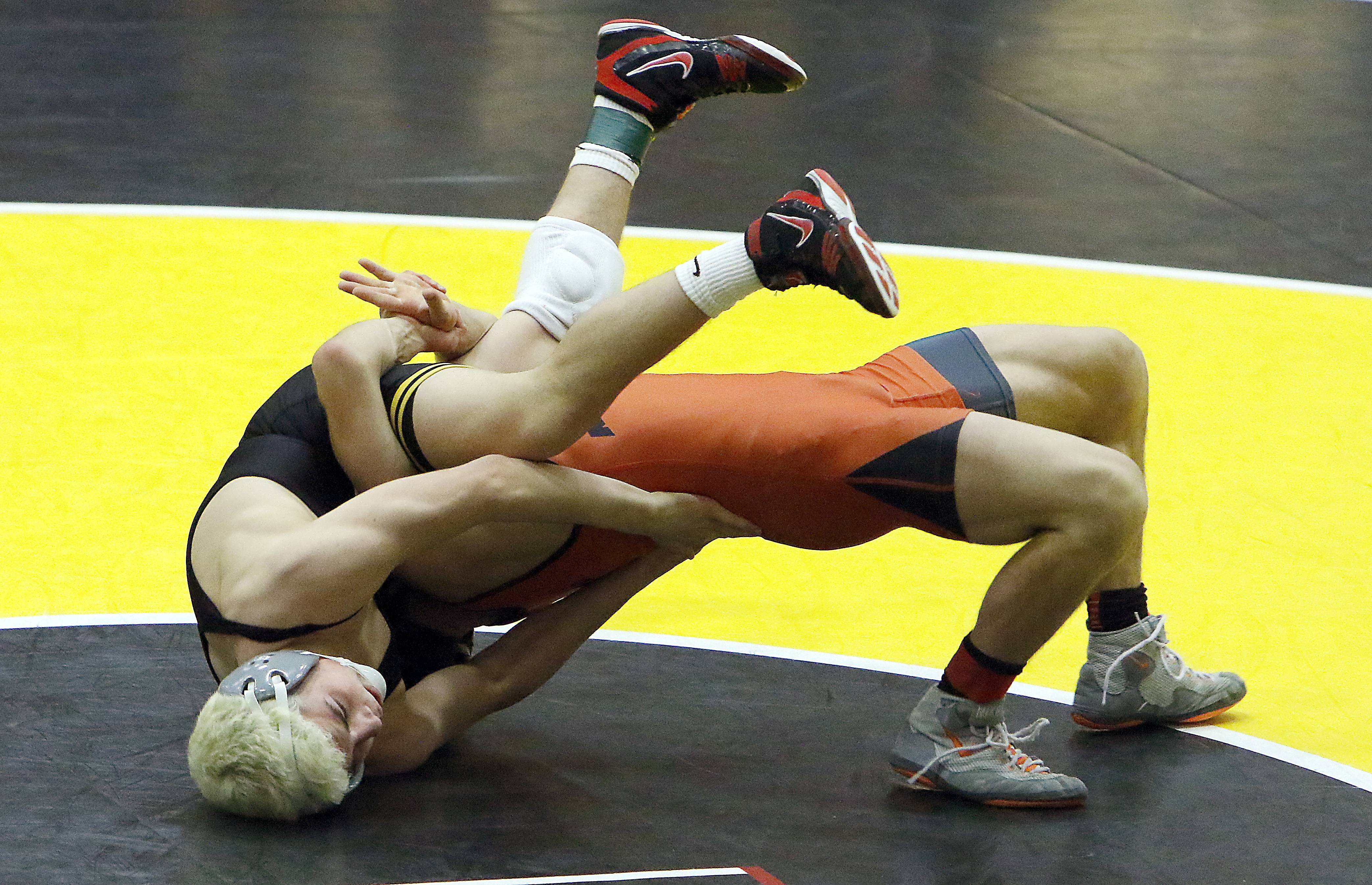 Glenbard North's Austin Gomez, left, will wrestle at 126 pounds Saturday at the Class 3A Conant individual sectional.