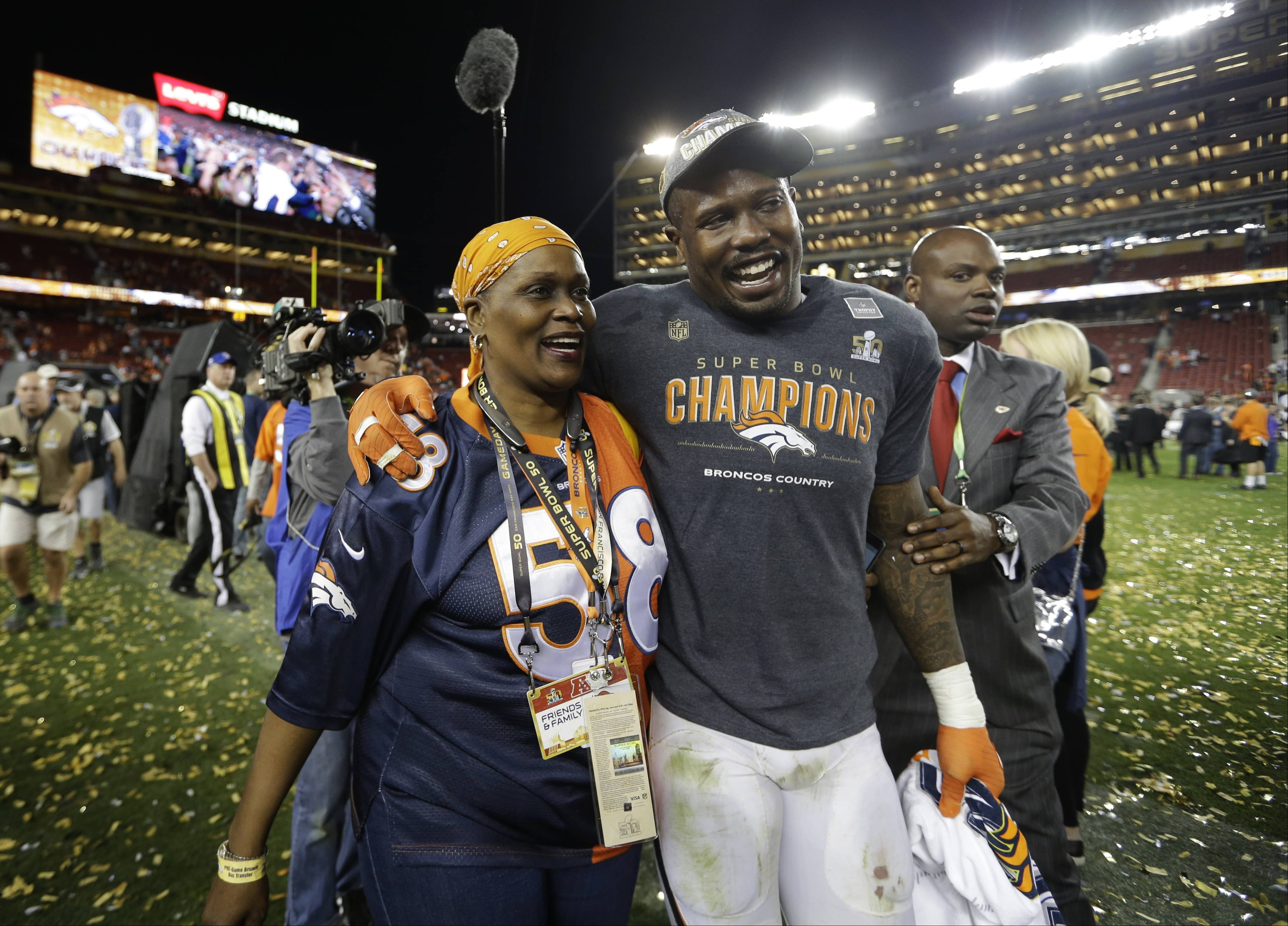 Denver Broncos linebacker and Super Bowl 50 MVP Von Miller walks off the field with his mother, Gloria, after Sunday's victory over the Carolina Panthers in Santa Clara, Calif. The Broncos won 24-10. (AP Photo/Jae C. Hong)