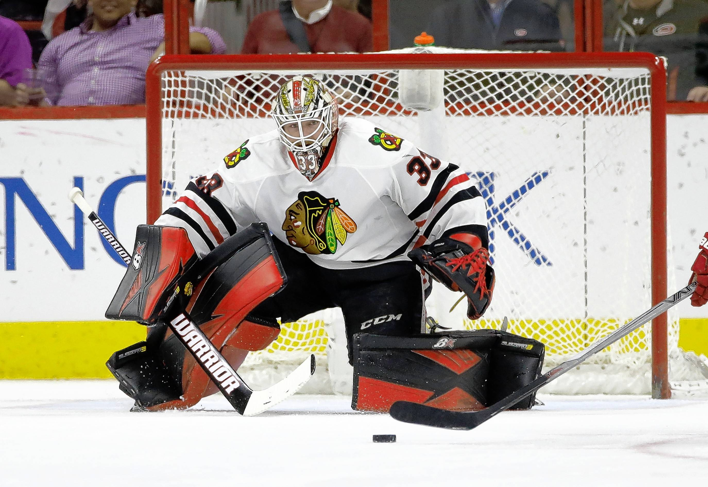 Chicago Blackhawks goalie Scott Darling (33) watches the puck during the second period of an NHL hockey game in Raleigh, N.C., Tuesday, Jan. 26, 2016. (AP Photo/Gerry Broome)