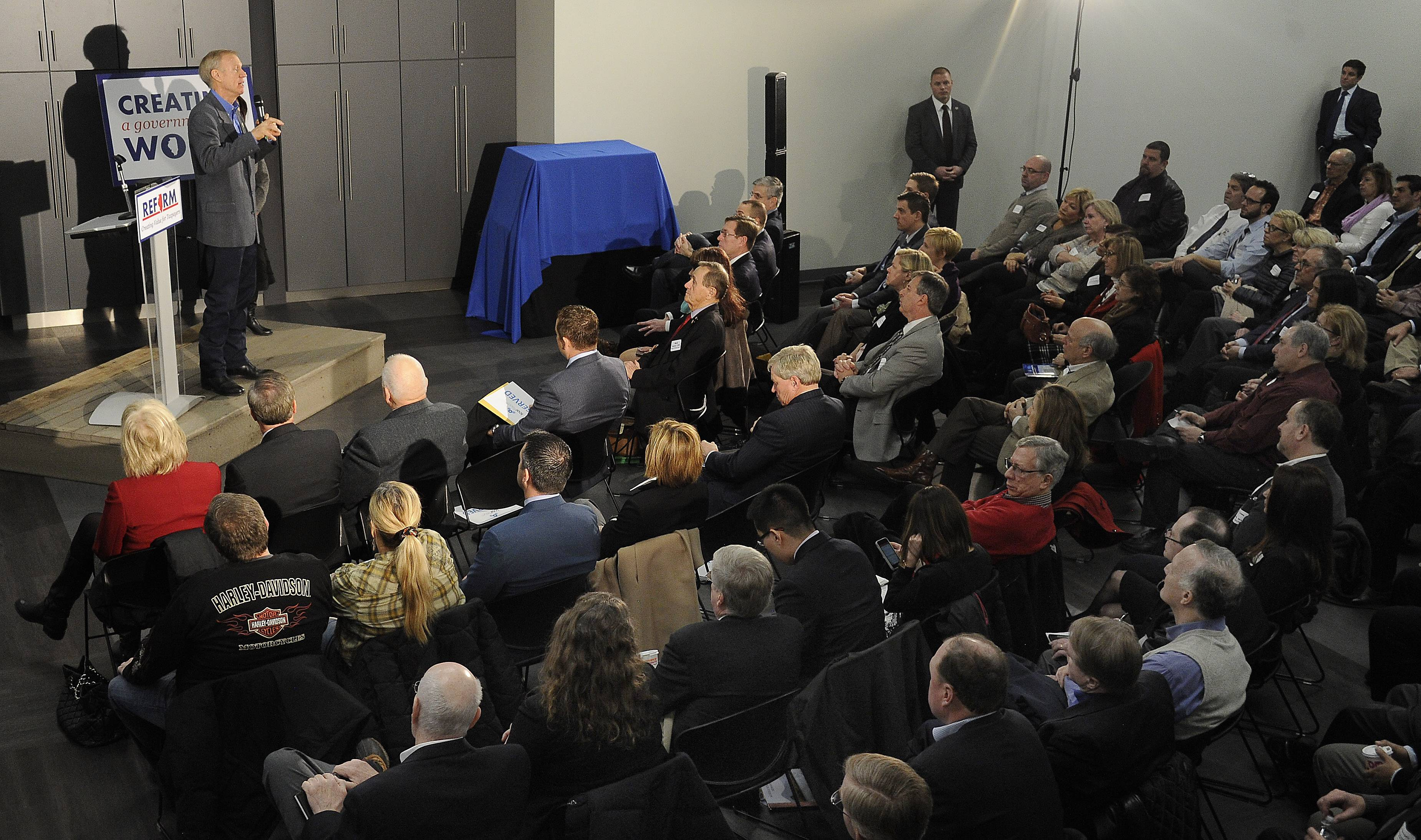 Gov. Bruce Rauner addresses a packed town-hall meeting Monday at the IcarTeam facility in Wheeling. Rauner told suburban business and community leaders that Illinois should look to Texas for ideas on how to improve the business climate.