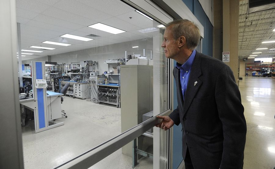 Gov. Bruce Rauner toured the IcarTeam facility in Wheeling on Monday before addressing Northwest suburban community and business leaders during a town-hall meeting focusing on business and job growth.